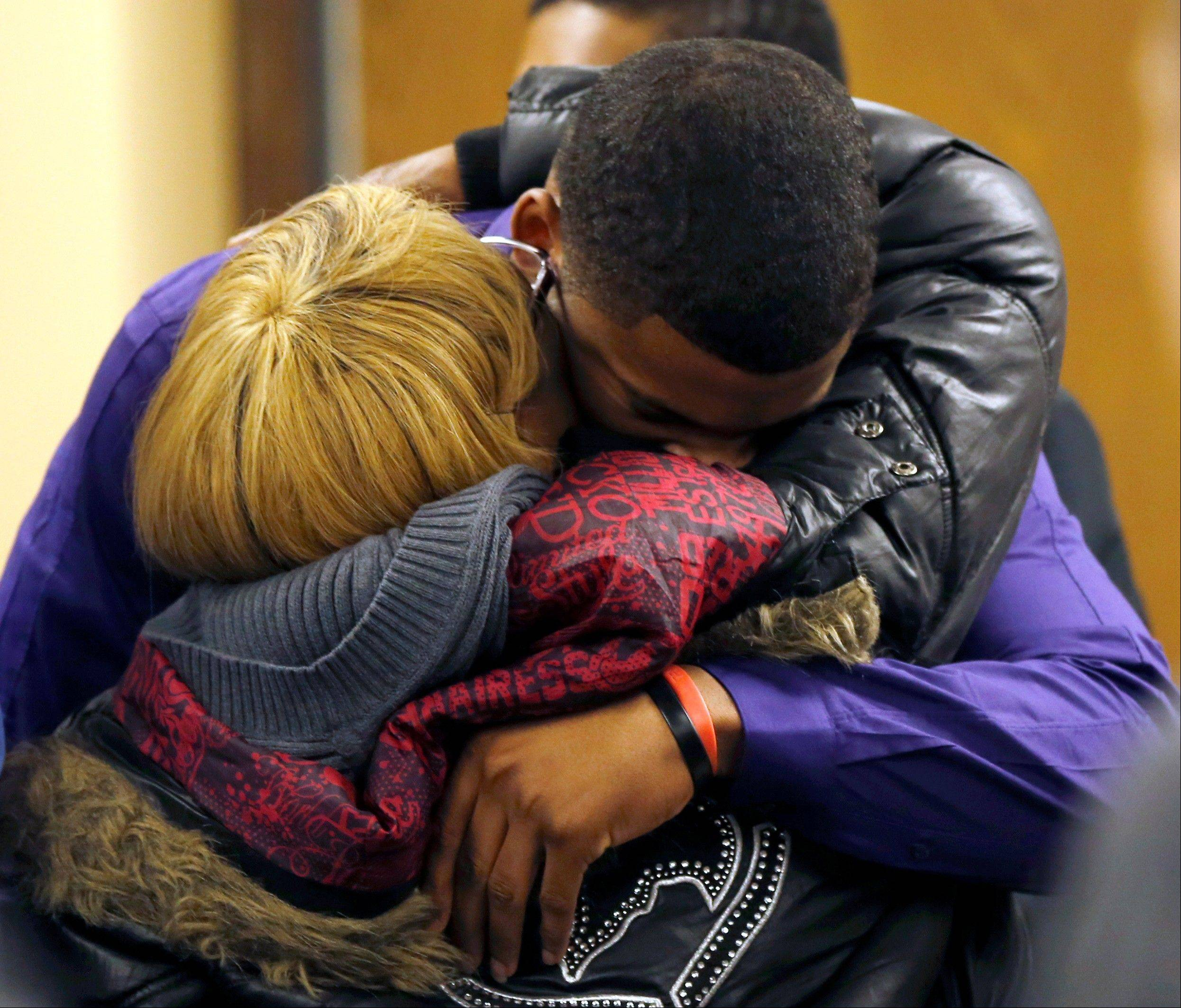 Ma'lik Richmond, 16, top, hugs his mother Daphne Birden, after closing arguments were made in the juvenile trial for him and co-defendant Trent Mays, 17, on rape charges.