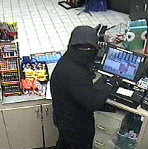 Police say the man in this surveillance photo is responsible for the stabbing death of a gas station clerk during a robbery early Saturday morning in Streamwood.