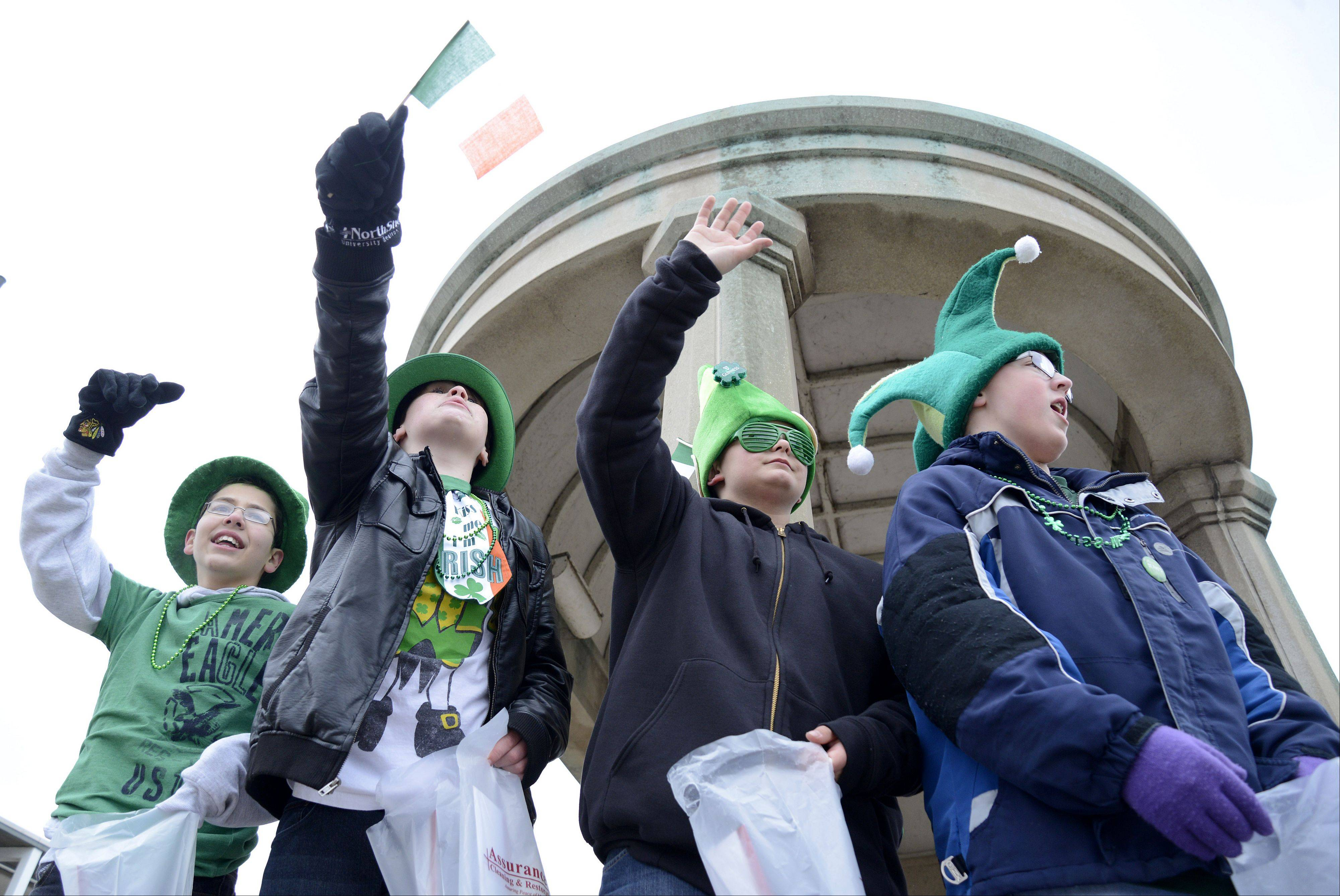 Alex Nicolas, Chase White, Joe Hanisch and Kevin Faulk, all 12 and from St. Charles, cheer on classic Corvettes in the St. Patrick's Day parade in St. Charles Saturday. Joe's 13th birthday is on St. Patrick's Day.