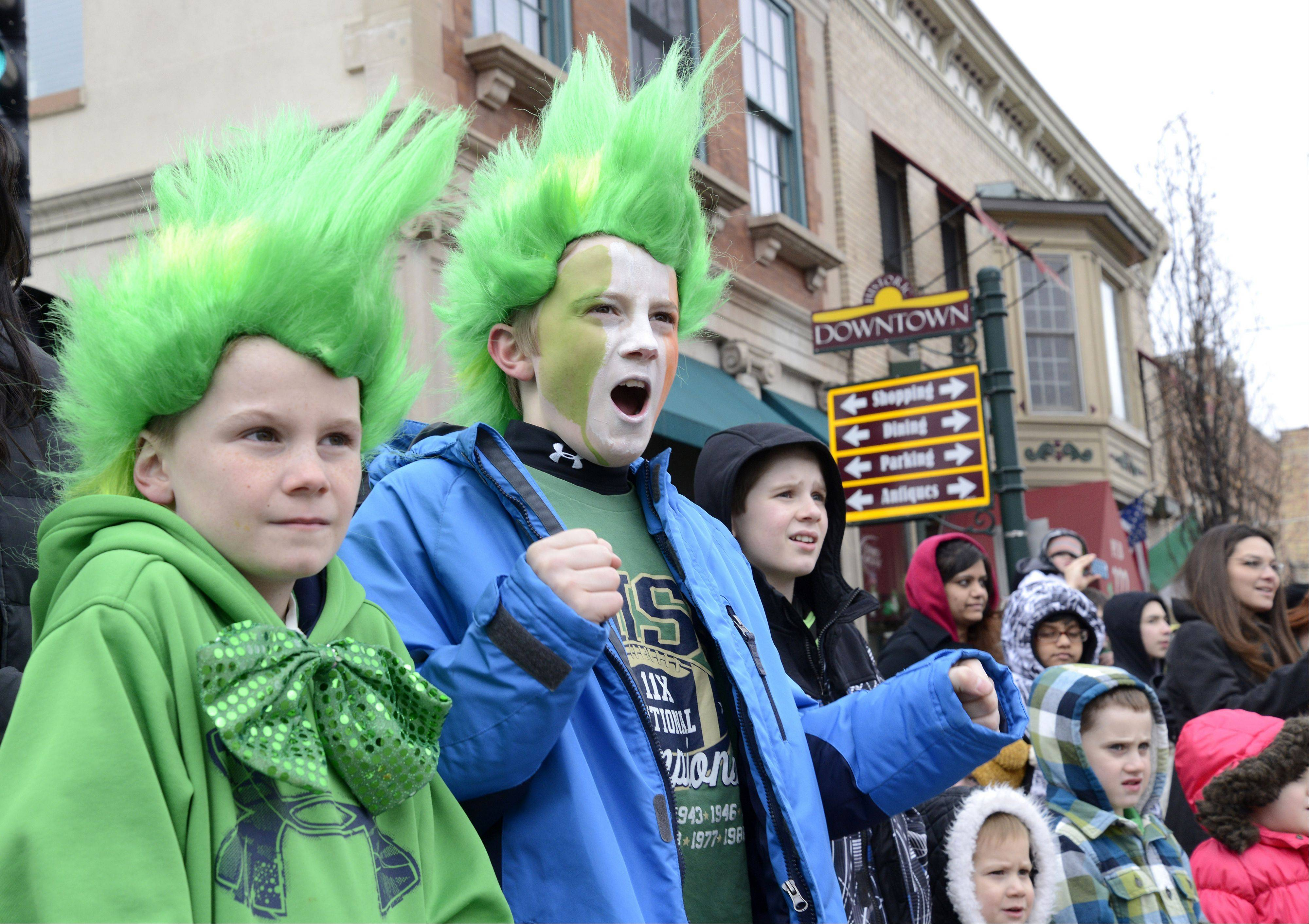 Daniel Shanahan, 9, left, and his brother Jameson, 12, of Geneva, watch the St. Patrick's Day parade in downtown St. Charles on Saturday. The boys and their sister, Kate, 6, come to the parade almost every year.