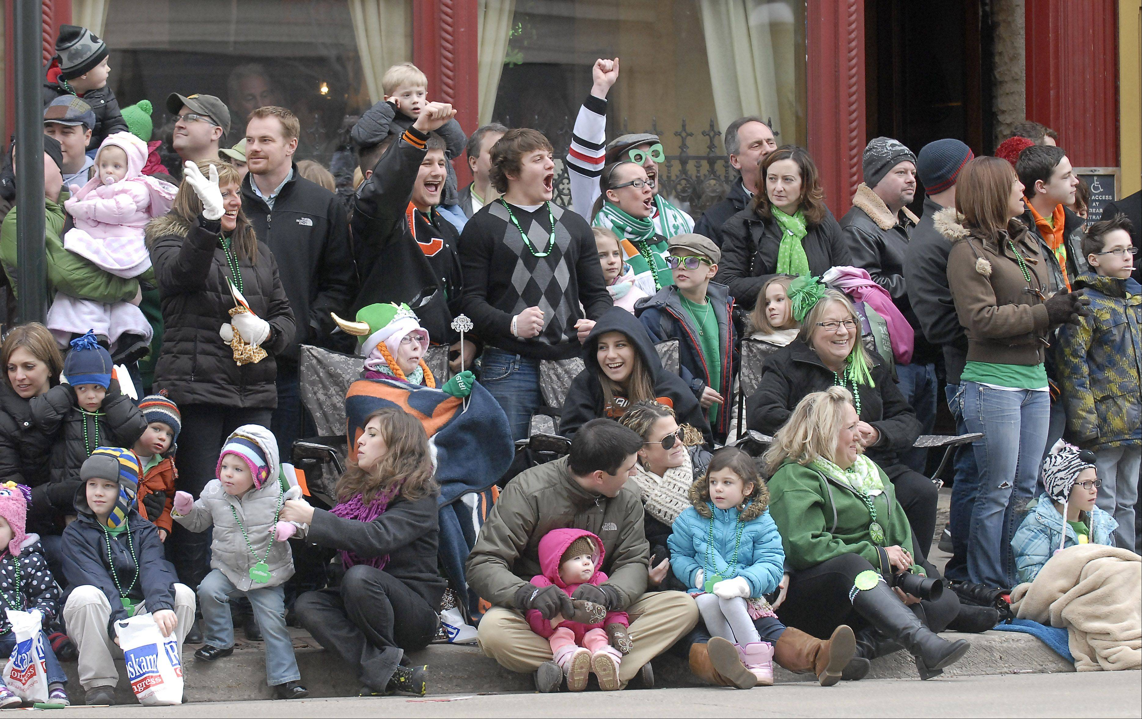 Crowds along Main Street enjoy the St. Patrick's Day parade in St. Charles Saturday.