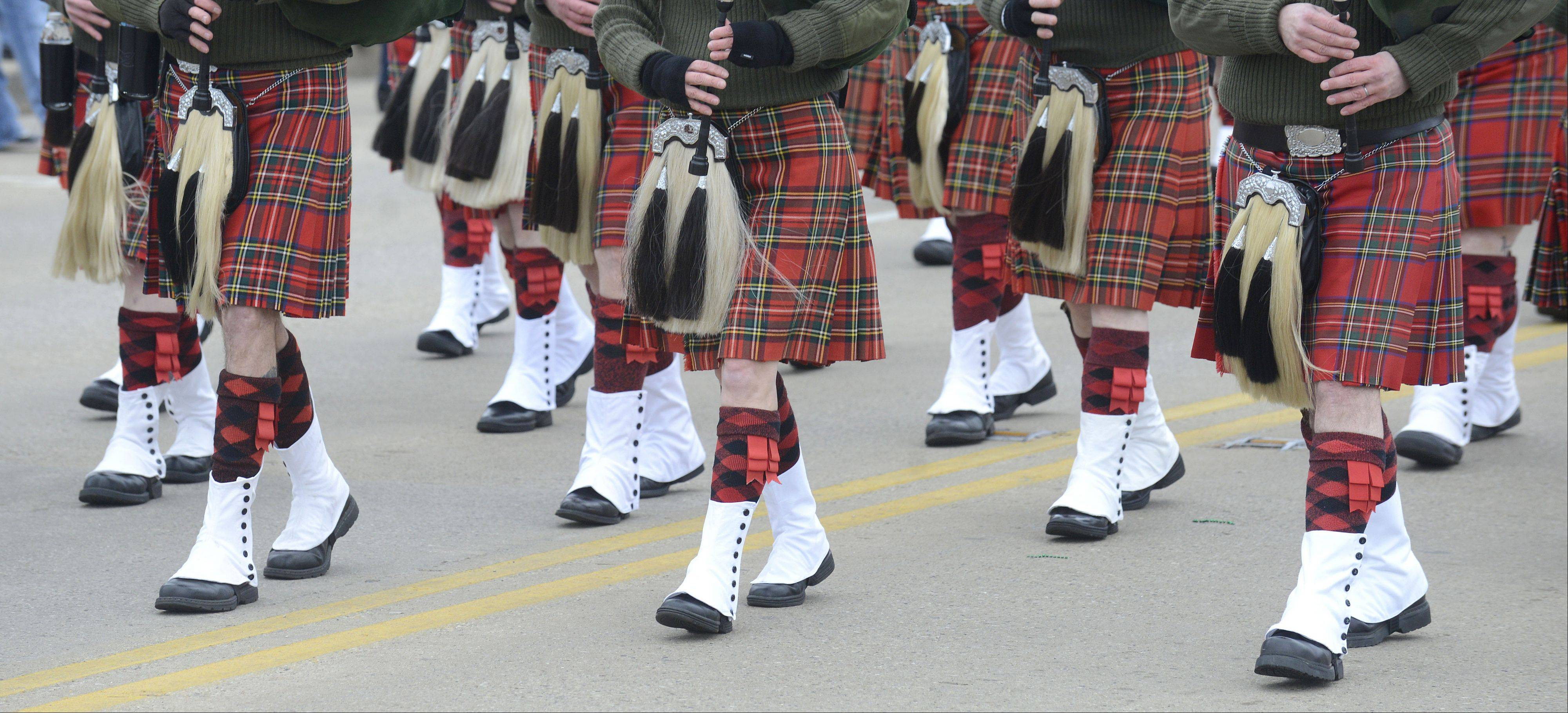 The Chicago Highlanders Pipes and Drums marches down Main Street in the St. Patrick's Day parade in St. Charles Saturday.