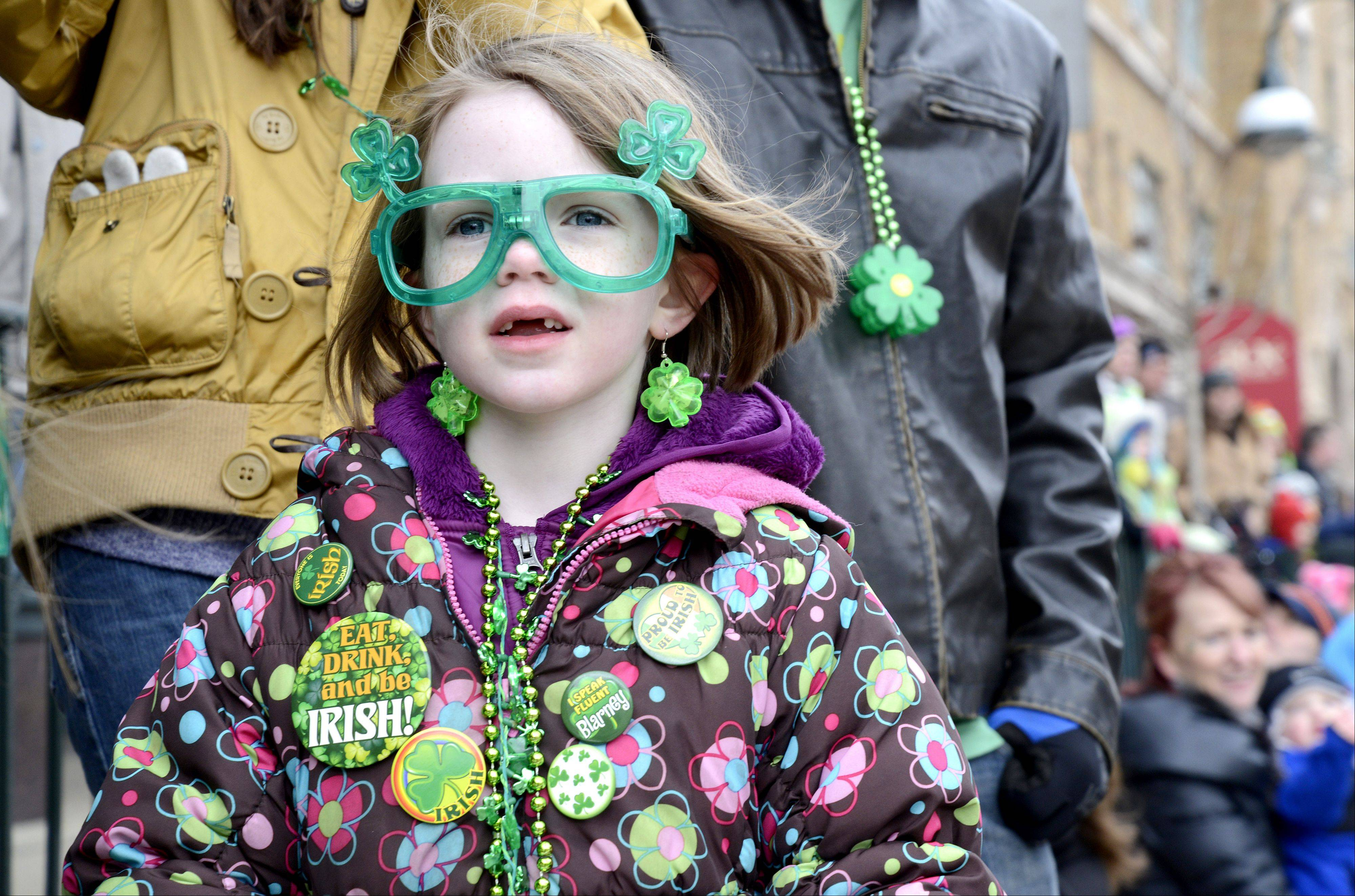 Shea Fink, 7, of Geneva watches the St. Patrick's Day parade in St. Charles on Saturday.
