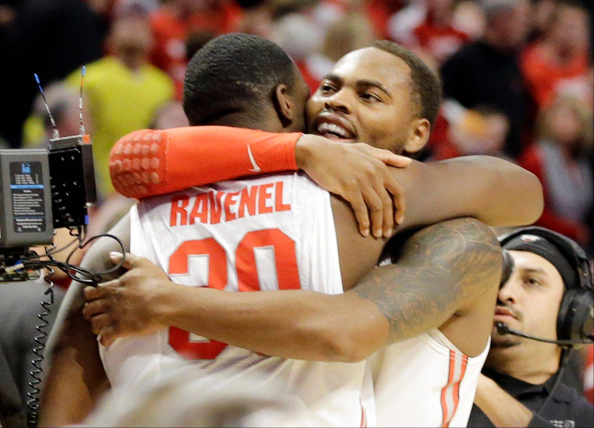 Ohio State forward Evan Ravenel and Ohio State forward Deshaun Thomas celebrate after an NCAA college basketball game against the Wisconsin in the championship of the Big Ten tournament Sunday, March 17, 2013, in Chicago. Ohio State won 50-43.
