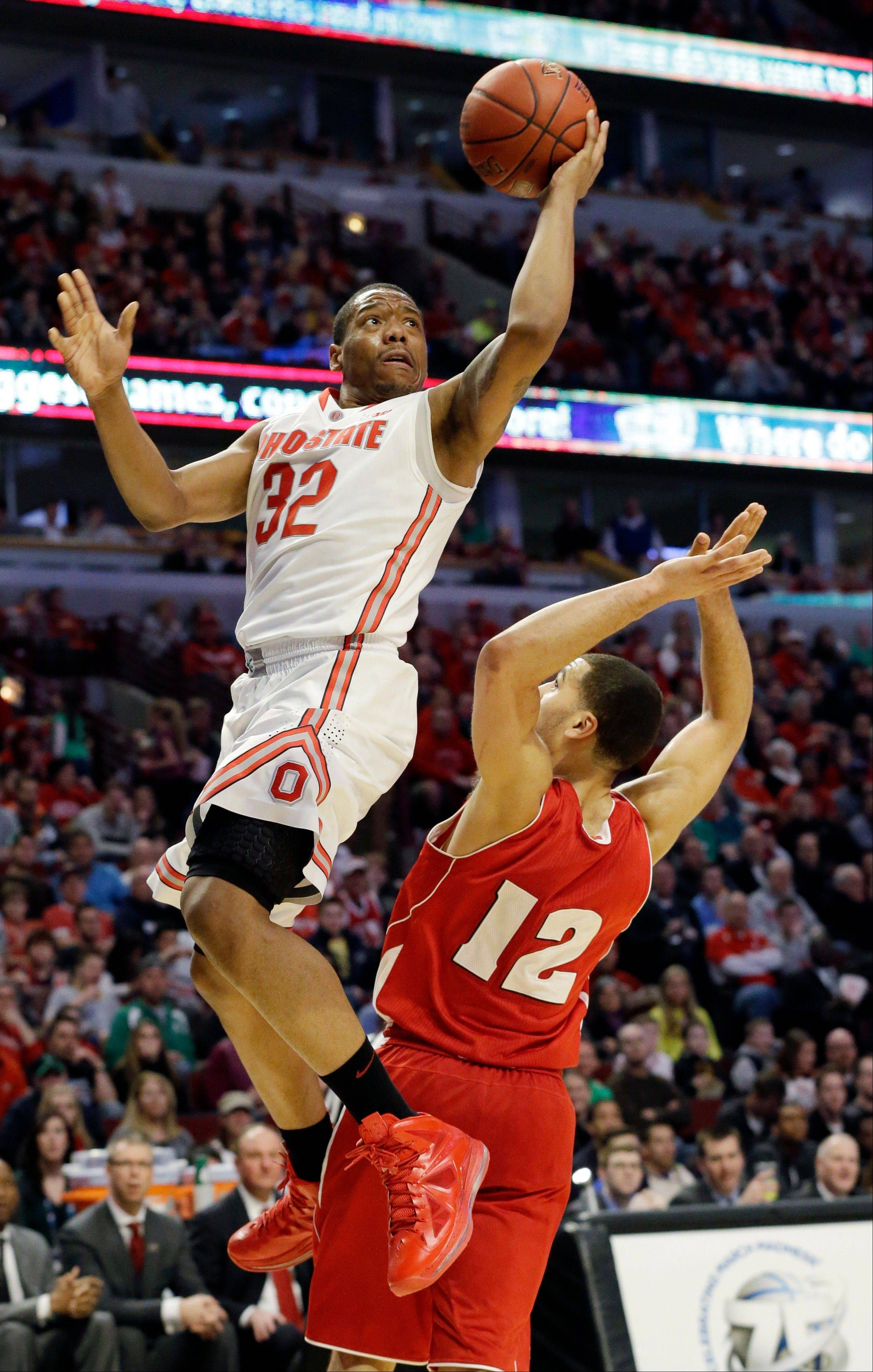 Ohio State guard Lenzelle Smith, Jr. goes up for a shot against Wisconsin guard Traevon Jackson during the second half of an NCAA college basketball game in the championship of the Big Ten tournament Sunday, March 17, 2013, in Chicago.