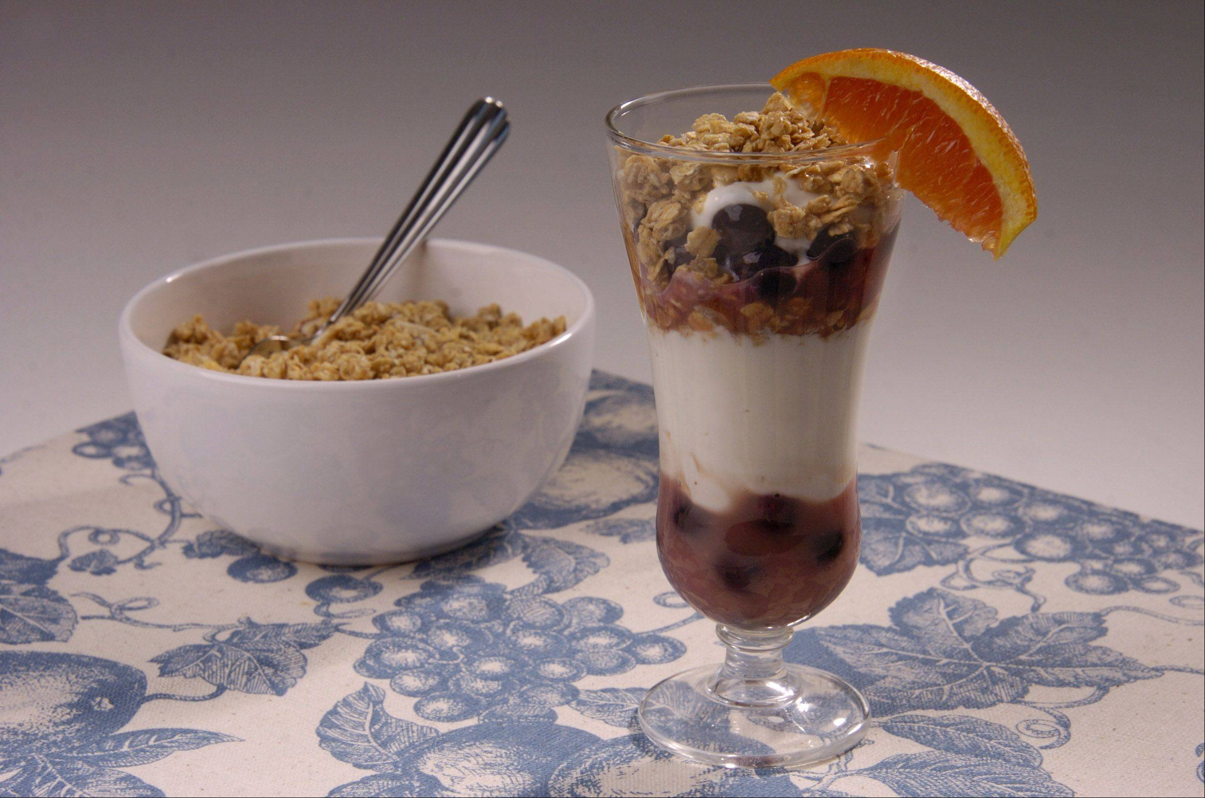 Orange-infused blueberry sauce and home-baked granola make this parfait a delicious and healthy dessert option.