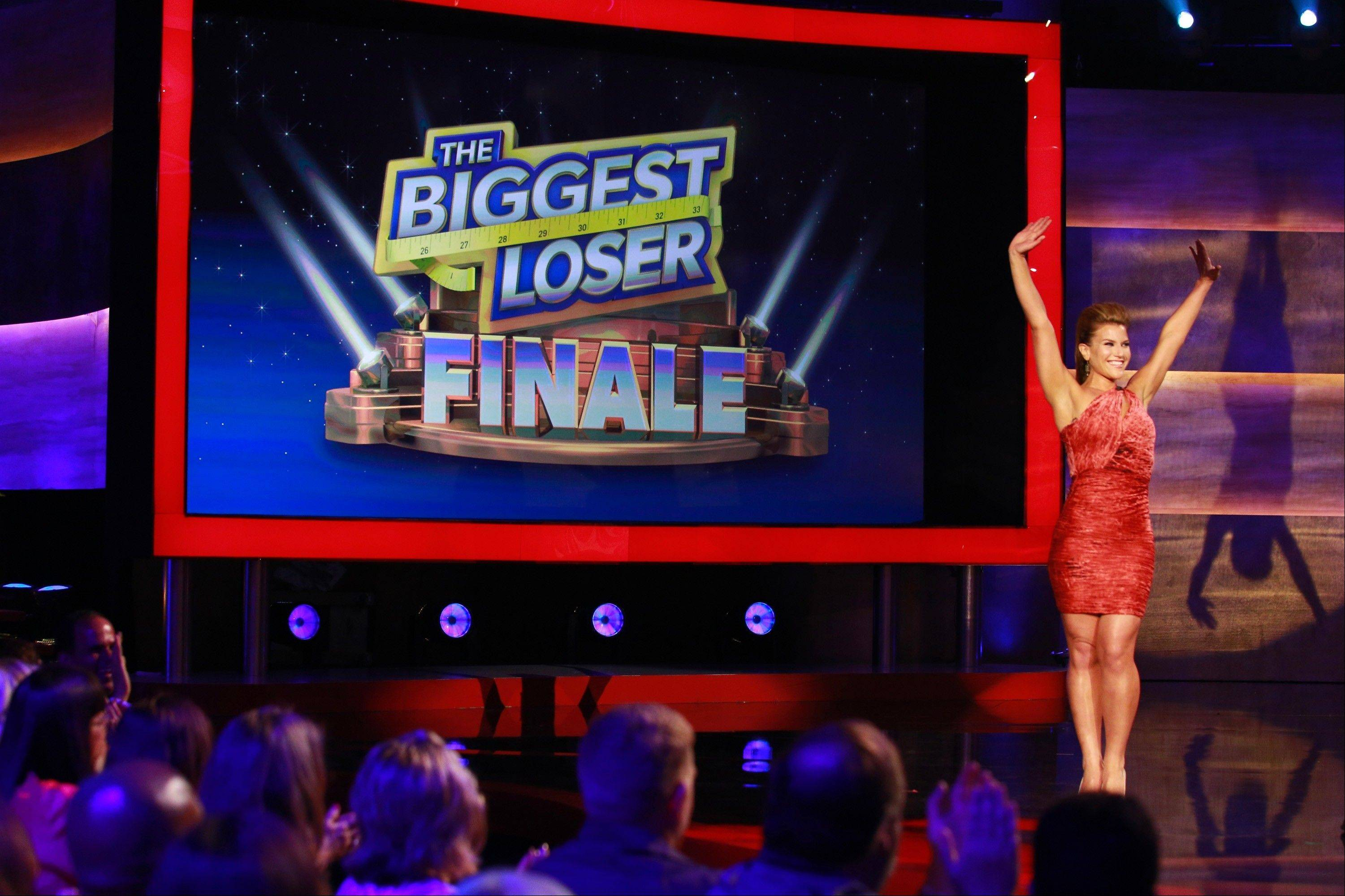 "Danni Allen of Wheeling greets the audience during the live finale of ""The Biggest Loser"" Monday night on NBC."