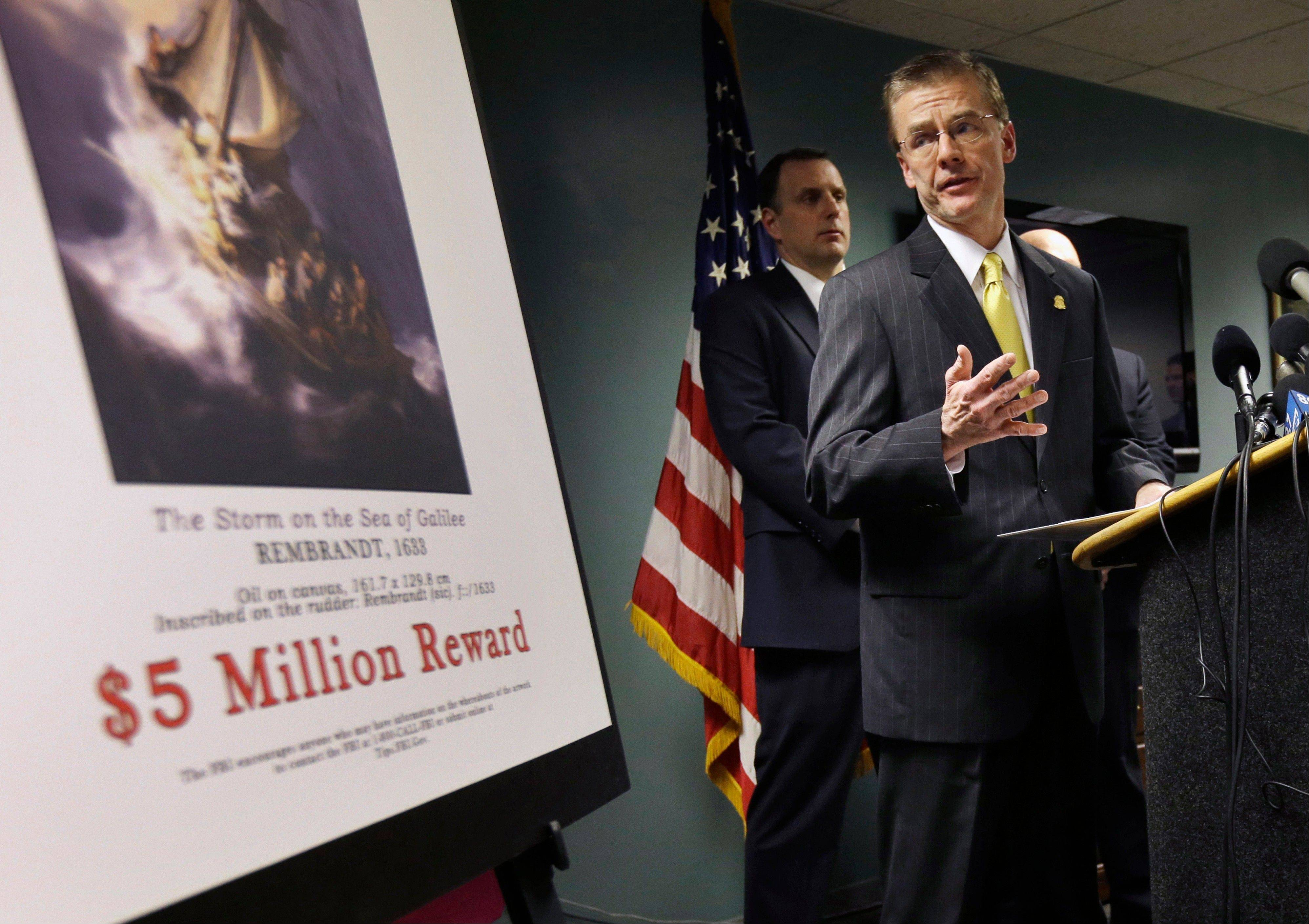FBI agent Richard DesLauriers, standing next to a poster that shows a Rembrandt painting and offers a reward, on Monday discusses the famed $500 million art theft that occurred in Boston in 1990.