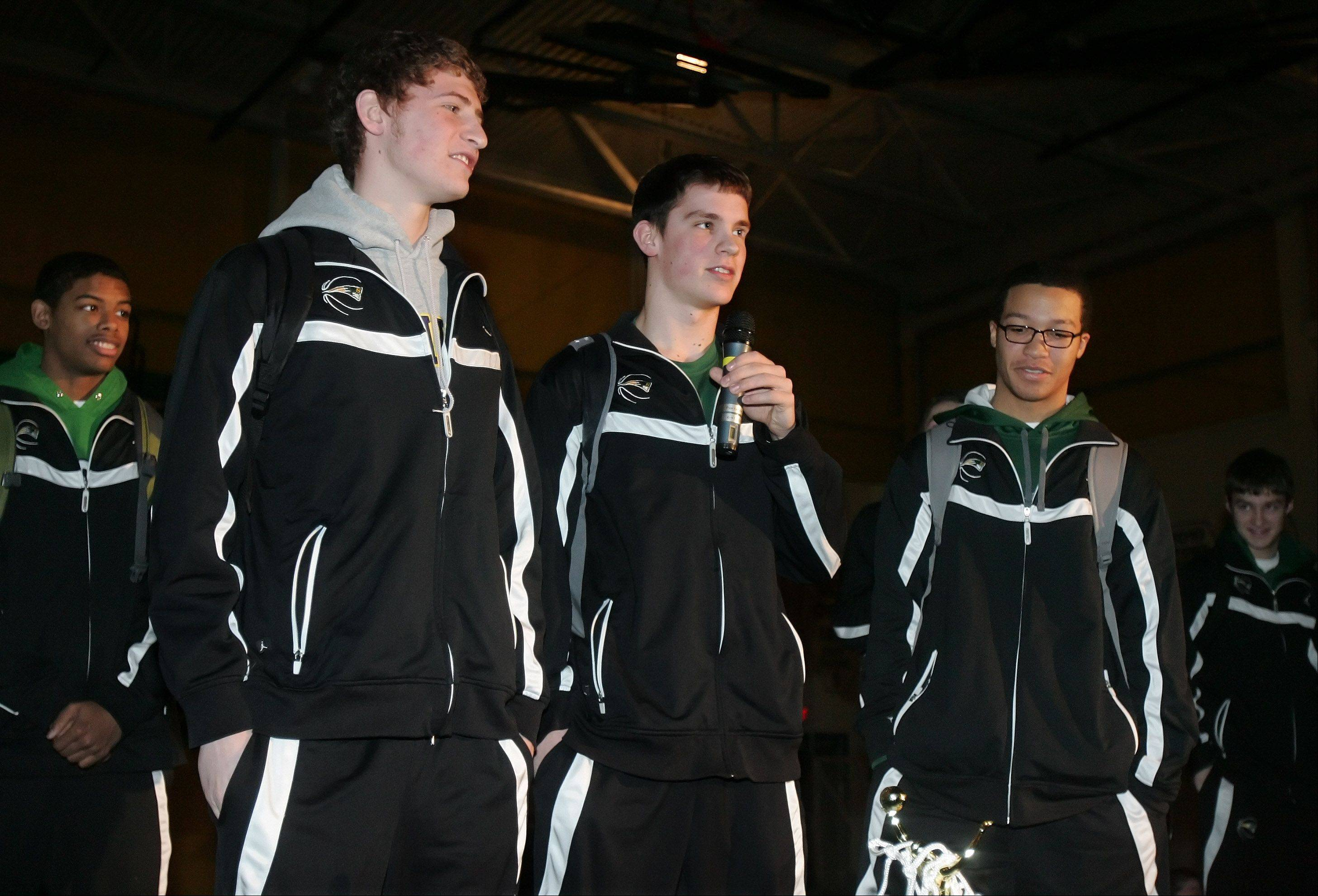 Stevenson High School boys basketball captains Andy Stempel, left, Matt Morrissey and Jalen Brunson speak to the fans at the school Monday as they celebrate the team's second-place finish in the state Class 4A tournament at Carver Arena in Peoria.