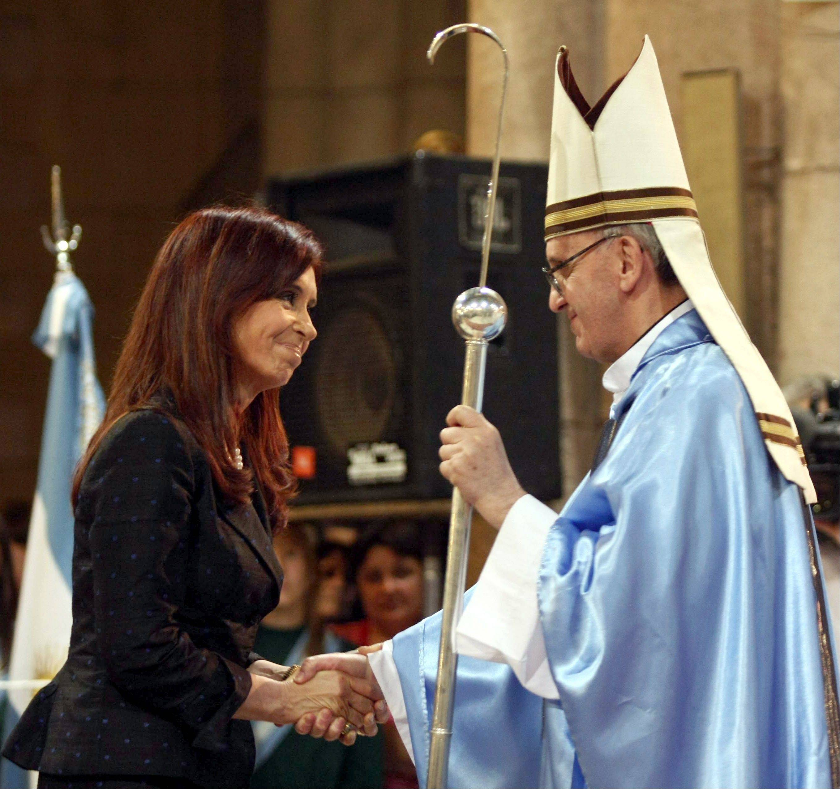 Argentina's President Cristina Fernandez, left, shakes hands with Buenos Aires' then-archbishop Jorge Mario Bergoglio in 2008 in Lujan, Argentina. Pope Francis' diplomatic skills were put to the test Monday as he lunched with Fernandez, with whom he has had a contentious relationship.