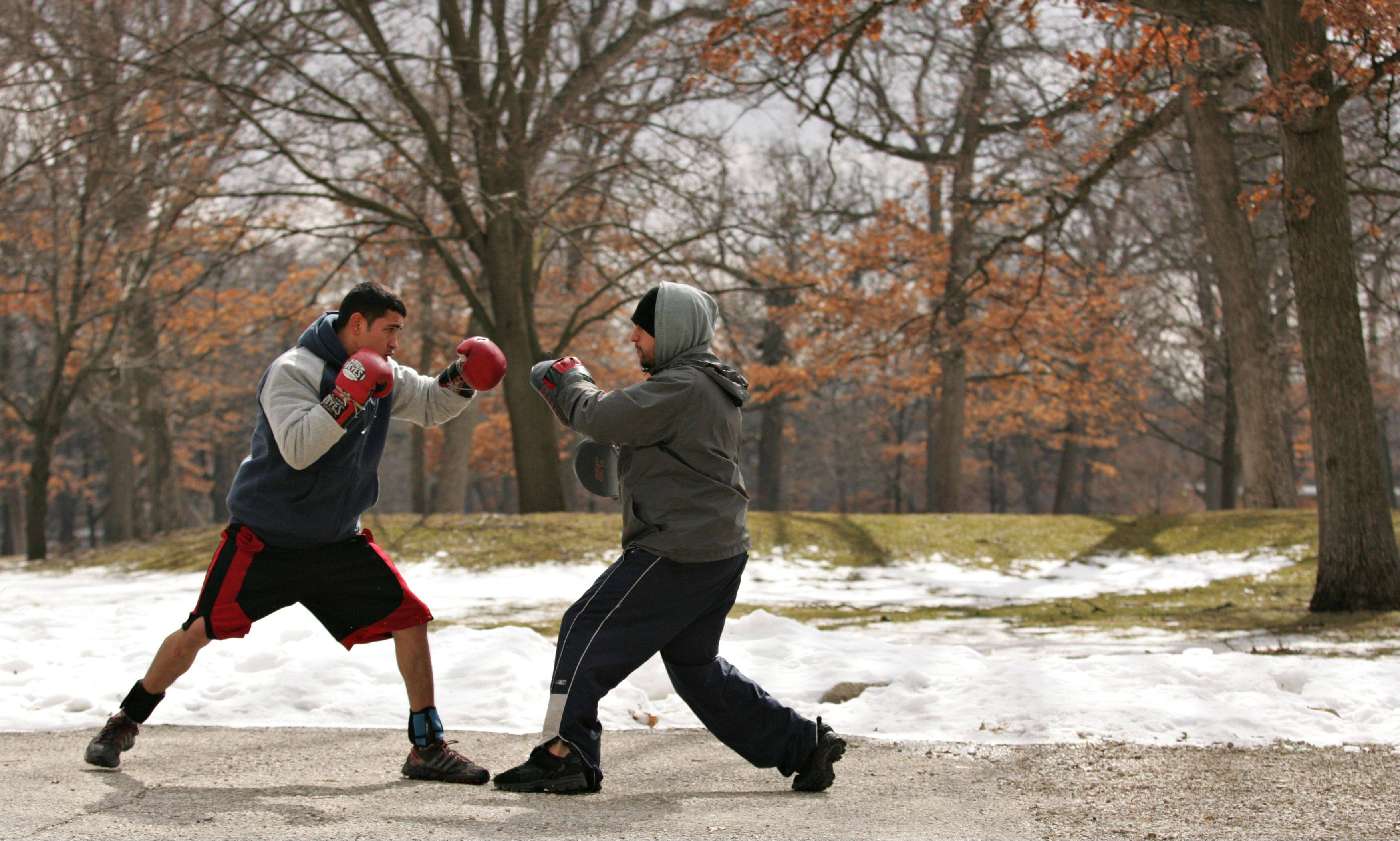 Samuel Sanchez, of Elgin, left, gets a sparring workout with his brother Miguel at Lords Park Tuesday in Elgin. The 25-year-old is an accomplished boxer, having won several titles in the featherweight class. Miguel says his brother has been boxing since he was 15.