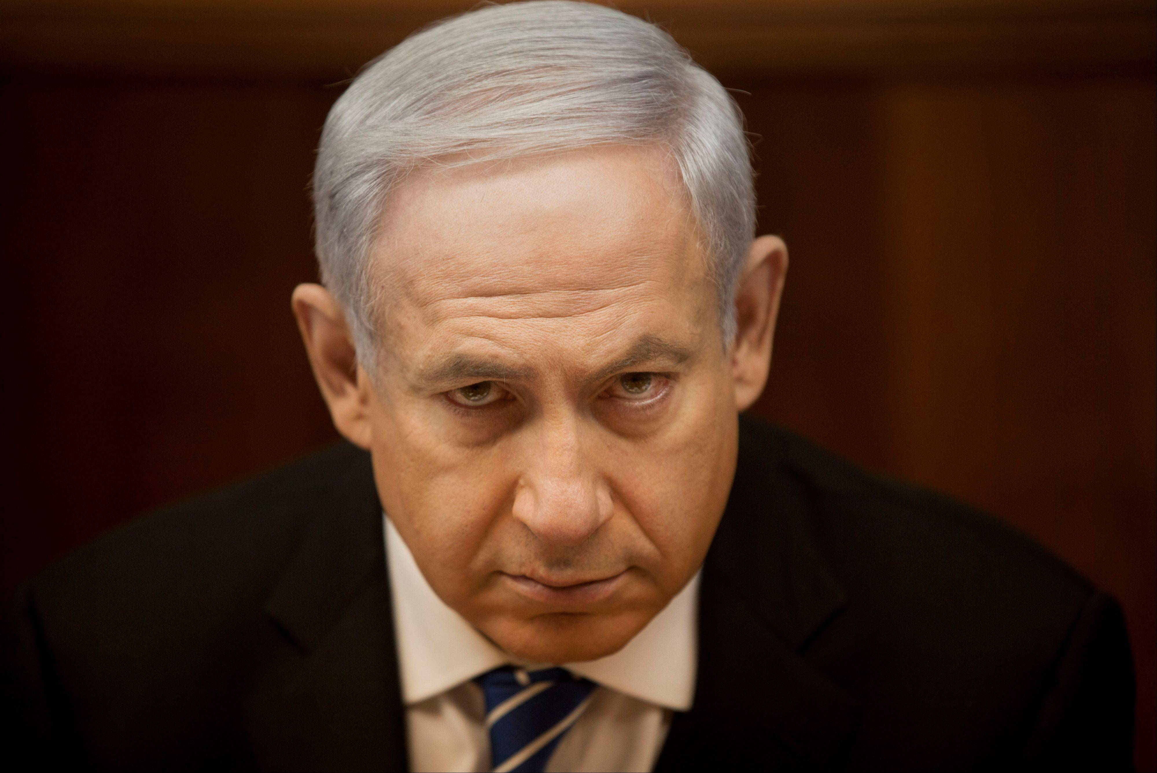 Israeli Prime Minister Benjamin Netanyahu says his new government is extending its hand in peace to the Palestinians.