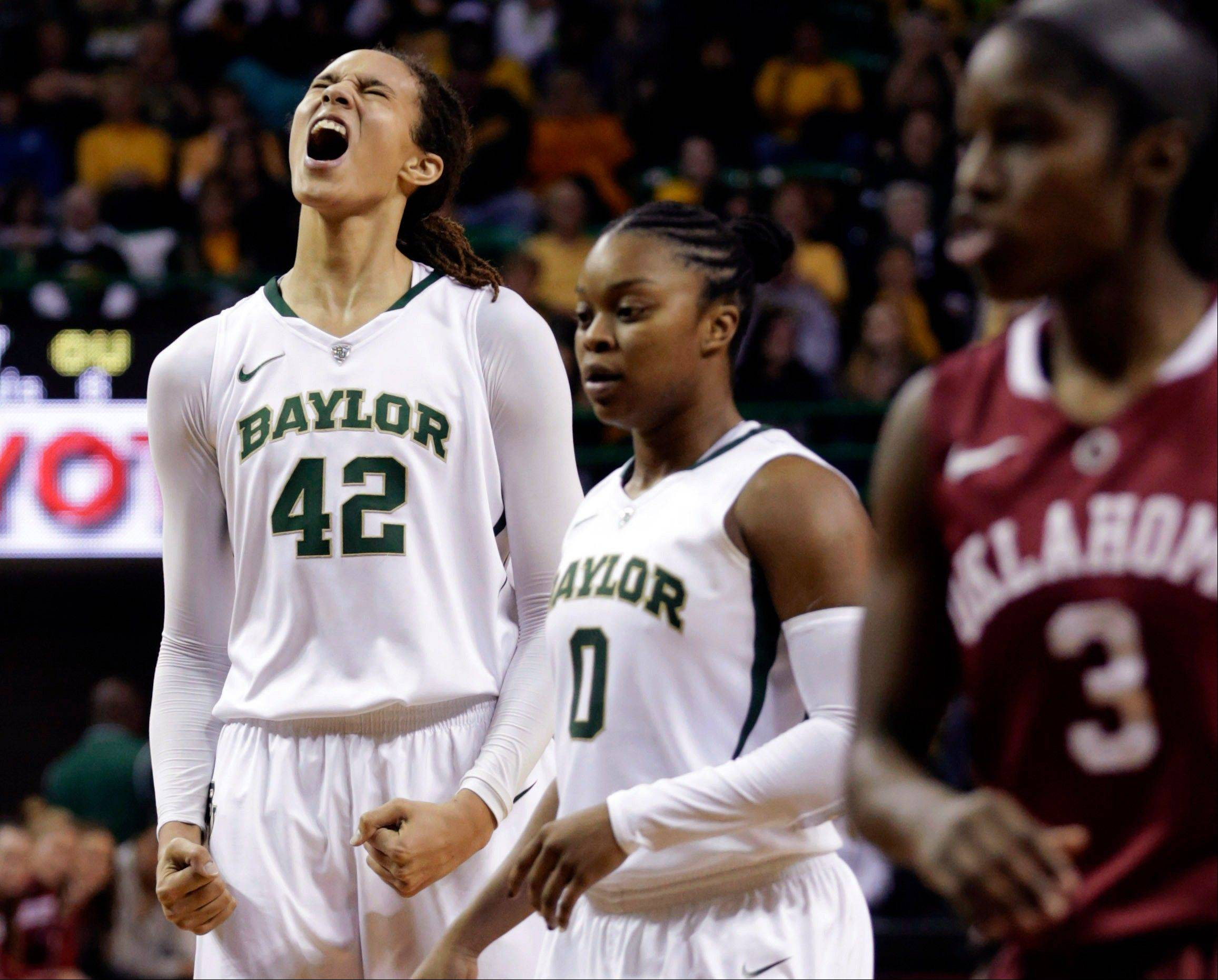 In this Jan. 26, 2013, file photo, Baylor's Brittney Griner (42) celebrates after breaking the NCAA women's career record for blocks as Odyssey Sims (0) and Oklahoma's Aaryn Ellenberg (3) stand by during the second half of a college basketball game in Waco Texas. Baylor was announced Monday, March 18, to join Connecticut, Stanford and Notre Dame as a No. 1 seed in the women's tournament, marking the second straight season those four schools were the top seeds.