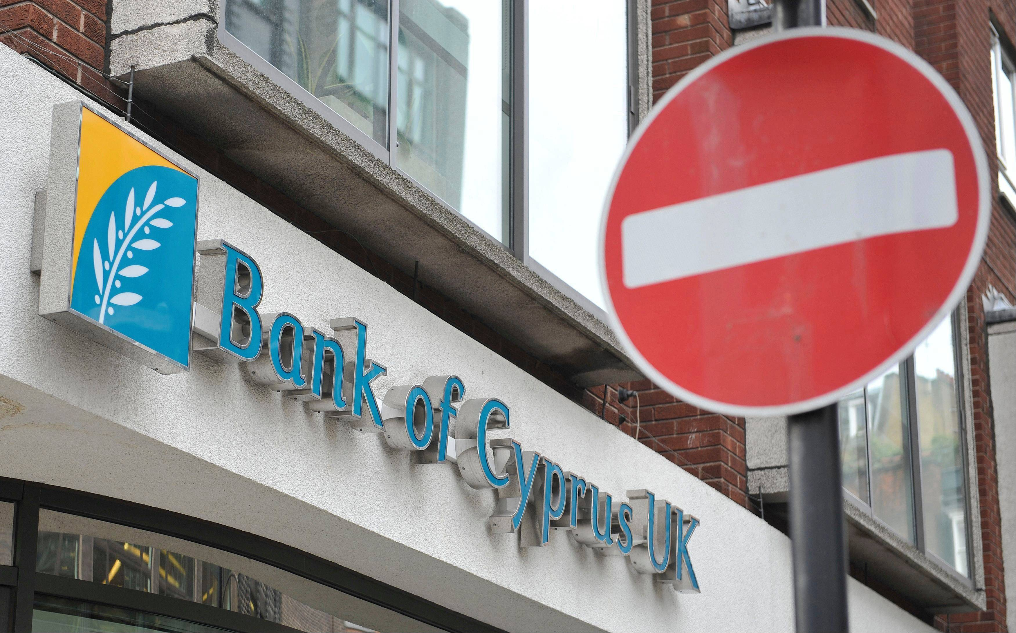 This is the Bank of Cyprus branch in London. Cyprus may agree to demanding that all bank customers pay a one-off levy on all bank deposits to save the country from bankruptcy.