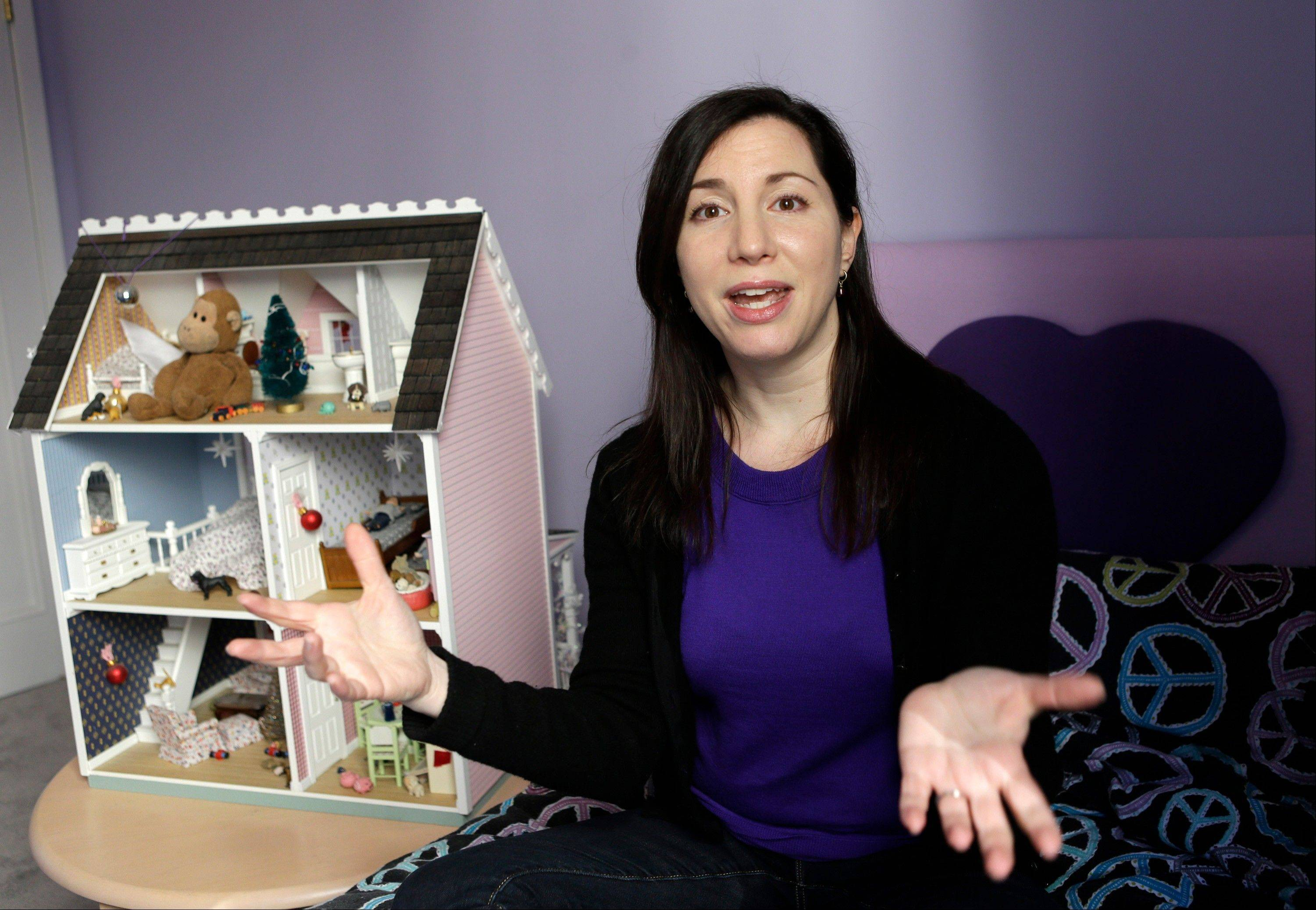 Rebecca Levey, mother of 10-year old twin daughters, is seen in her girls' bedroom in New York.