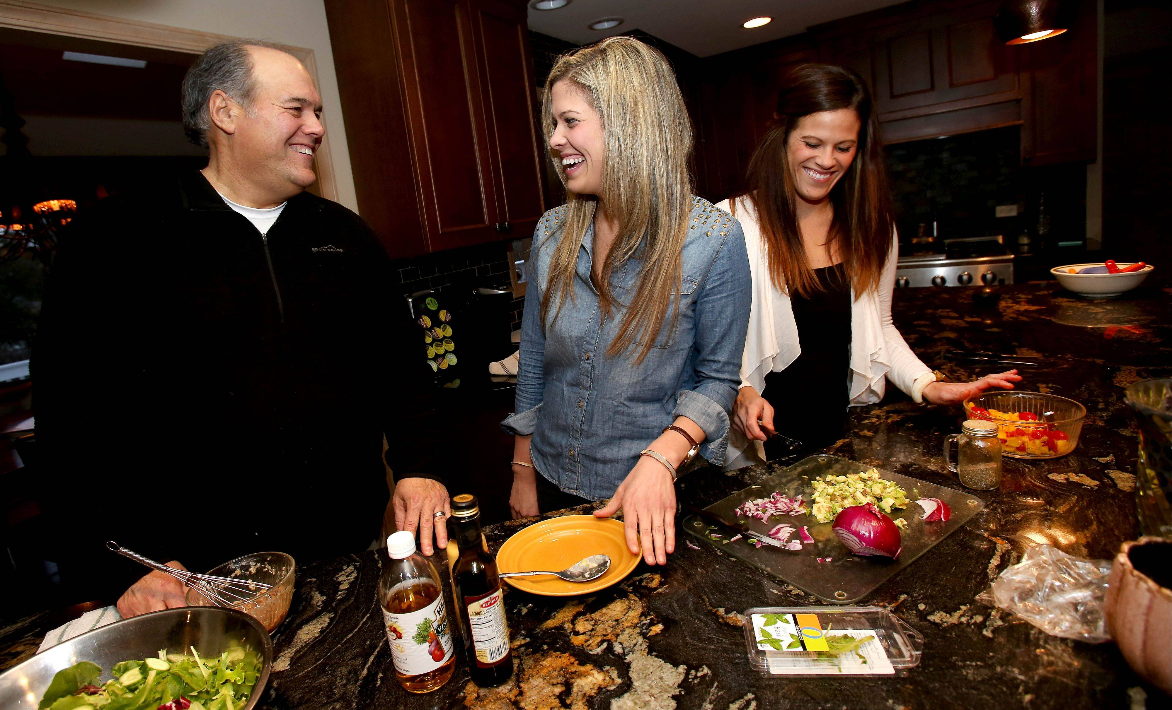 Fittest Loser Mike Paulo gets some help in the kitchen from his 25-year-old twin daughters, Nina and Natalie.