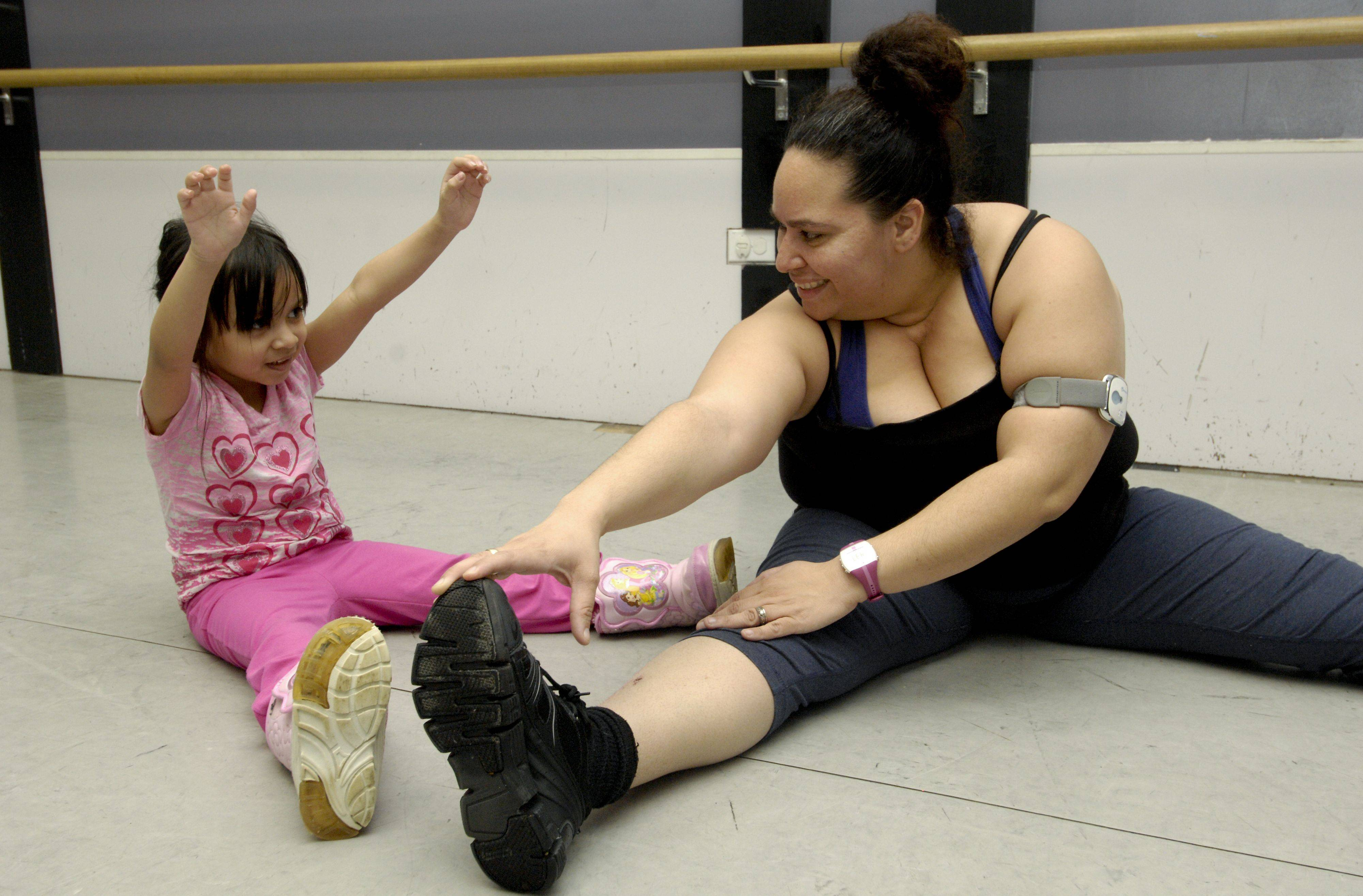 Fittest Loser contestant Marianne Costales-Roman stretches with her daughter Selena Gloria Costales-Roman, 4 at the Center Stage Dance Studio in Bloomingdale.