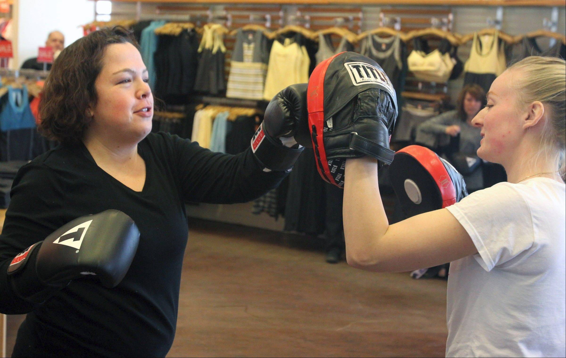 Karen Castillo is hanging tough despite struggling on the scale. Recently she had an opportunity to check out a Power Hour workout demo at the Lucy store at Deer Park Town Center with Title Boxing Club of Lake Zurich manager Michelle Sikorski.