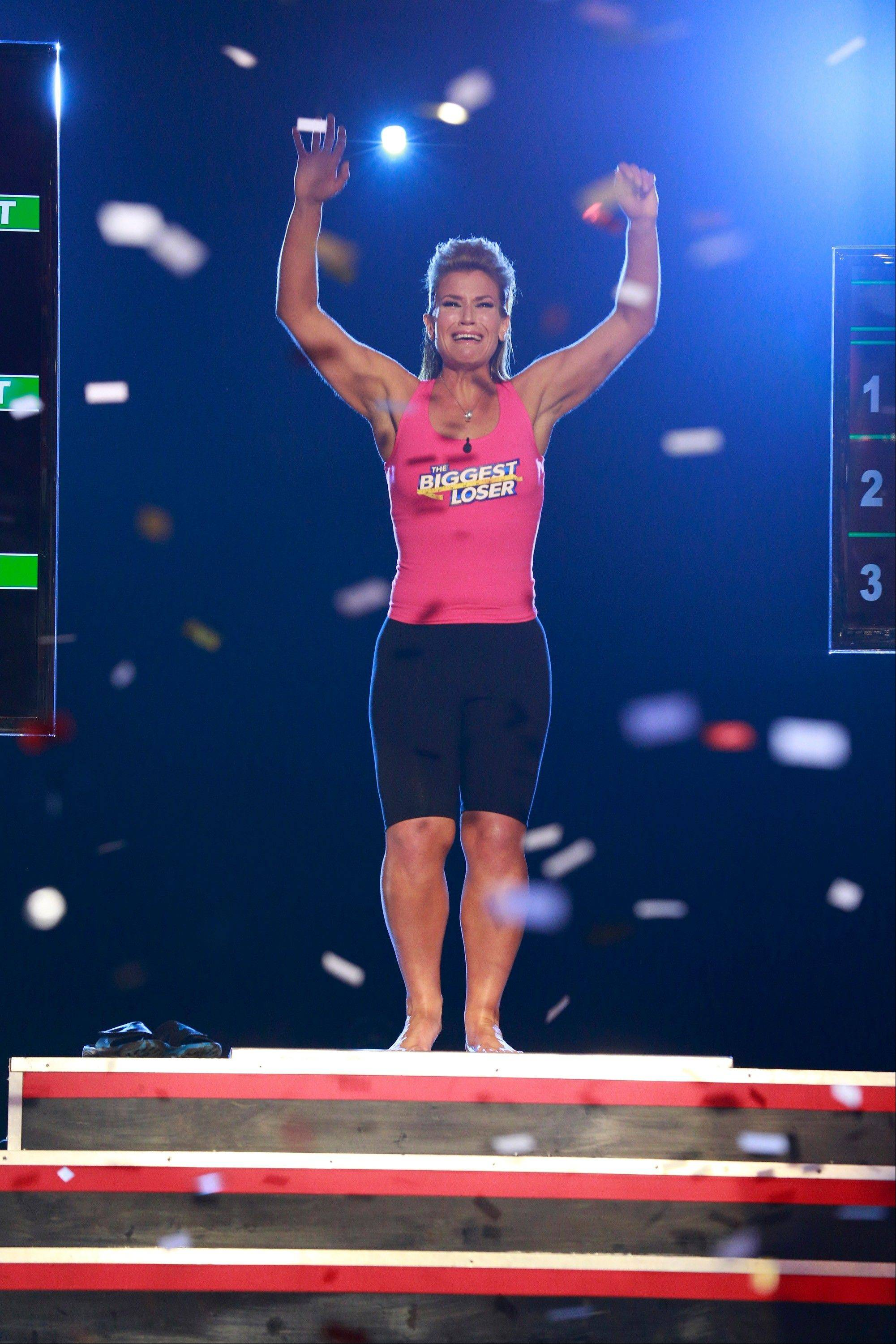 "Danni Allen of Wheeling celebrates as the confetti comes down after her win on ""The Biggest Loser"" Monday night on NBC."