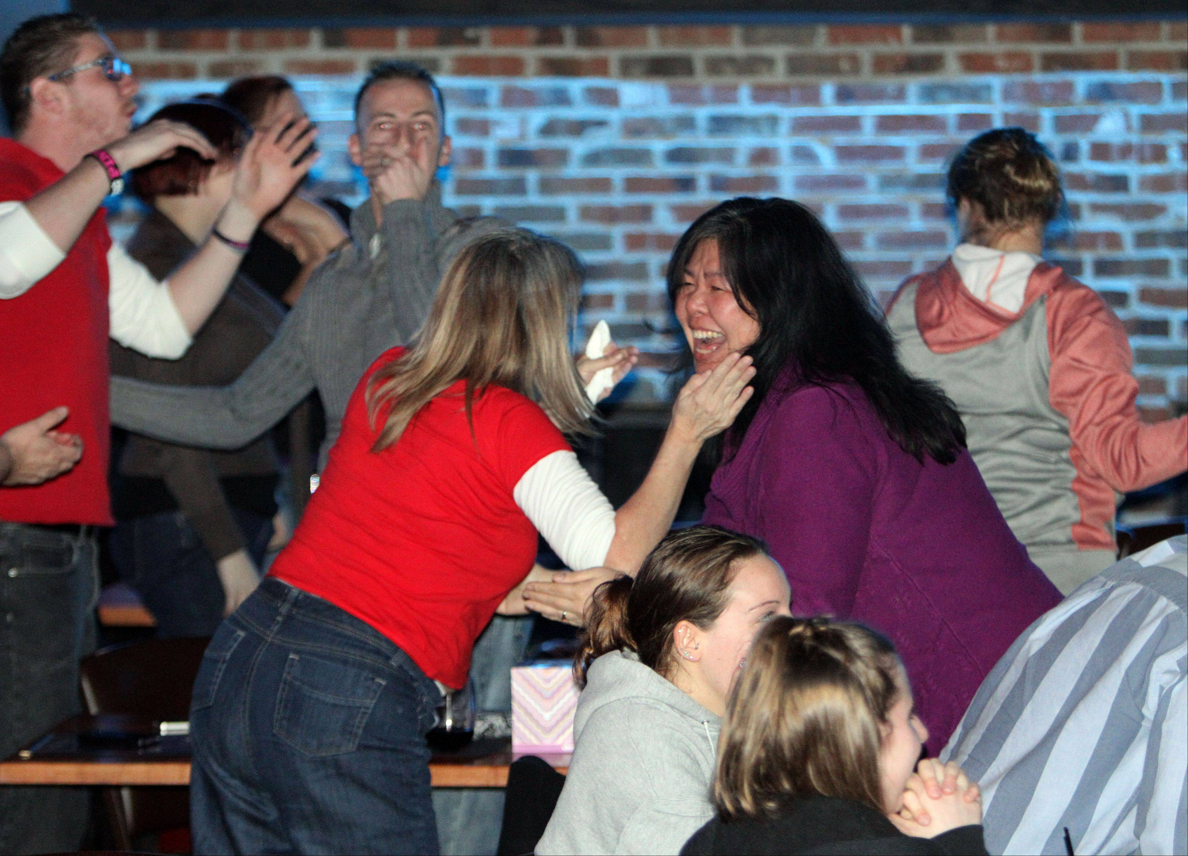 "Friends cheer as Danni Allen of Wheeling wins ""The Biggest Loser"" competition during a viewing party Monday night at Viper Alley in Lincolnshire."
