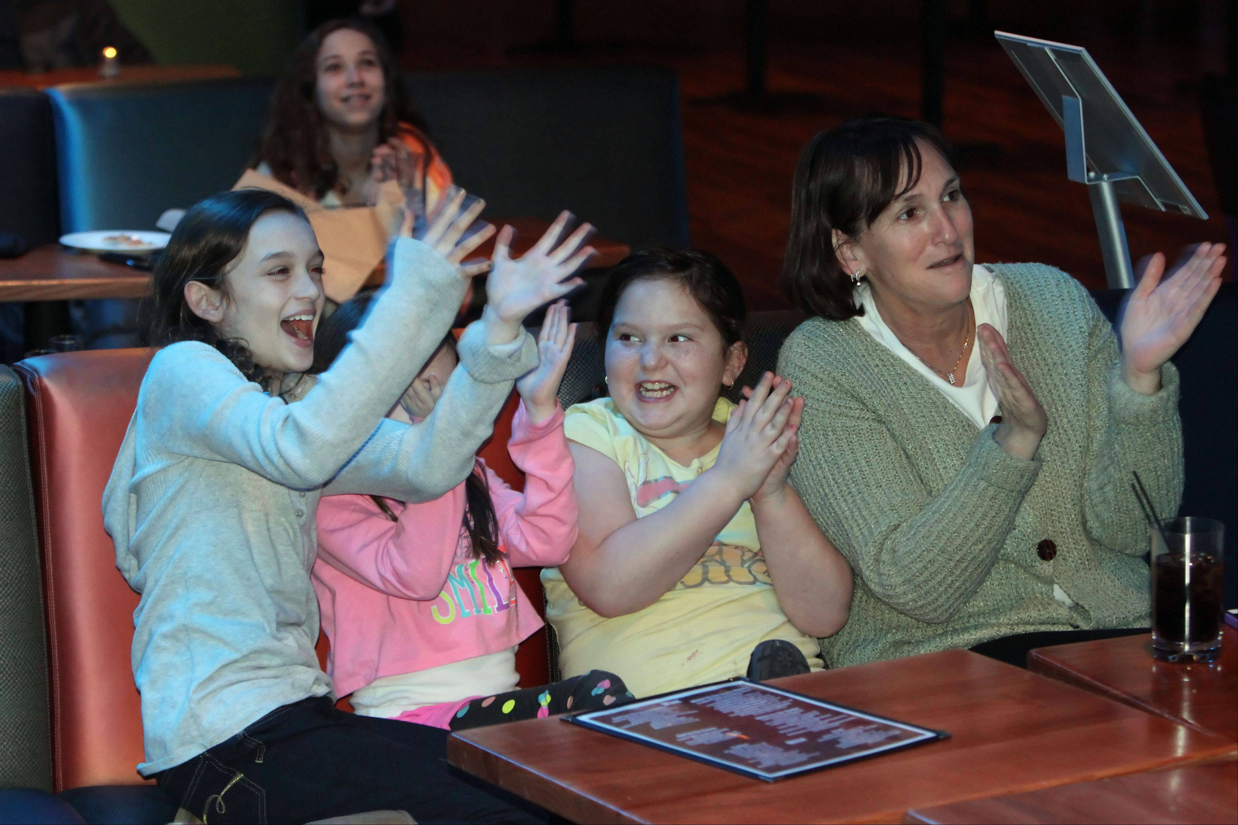 "Friends from left, Sydney Summerfeld, 10, Abby Summerfield, 9, Sophie Cohn, 9 and Laurie Cohn, all of Northbrook, cheer as Danni Allen of Wheeling wins ""The Biggest Loser"" competition during a viewing party Monday night at Viper Alley in Lincolnshire."