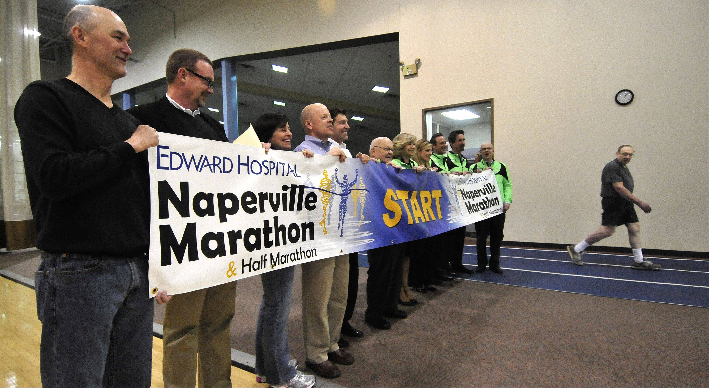 The Edward Hospital Naperville Marathon's starting banner was unfurled Monday at Edward Health & Fitness Center in Naperville.