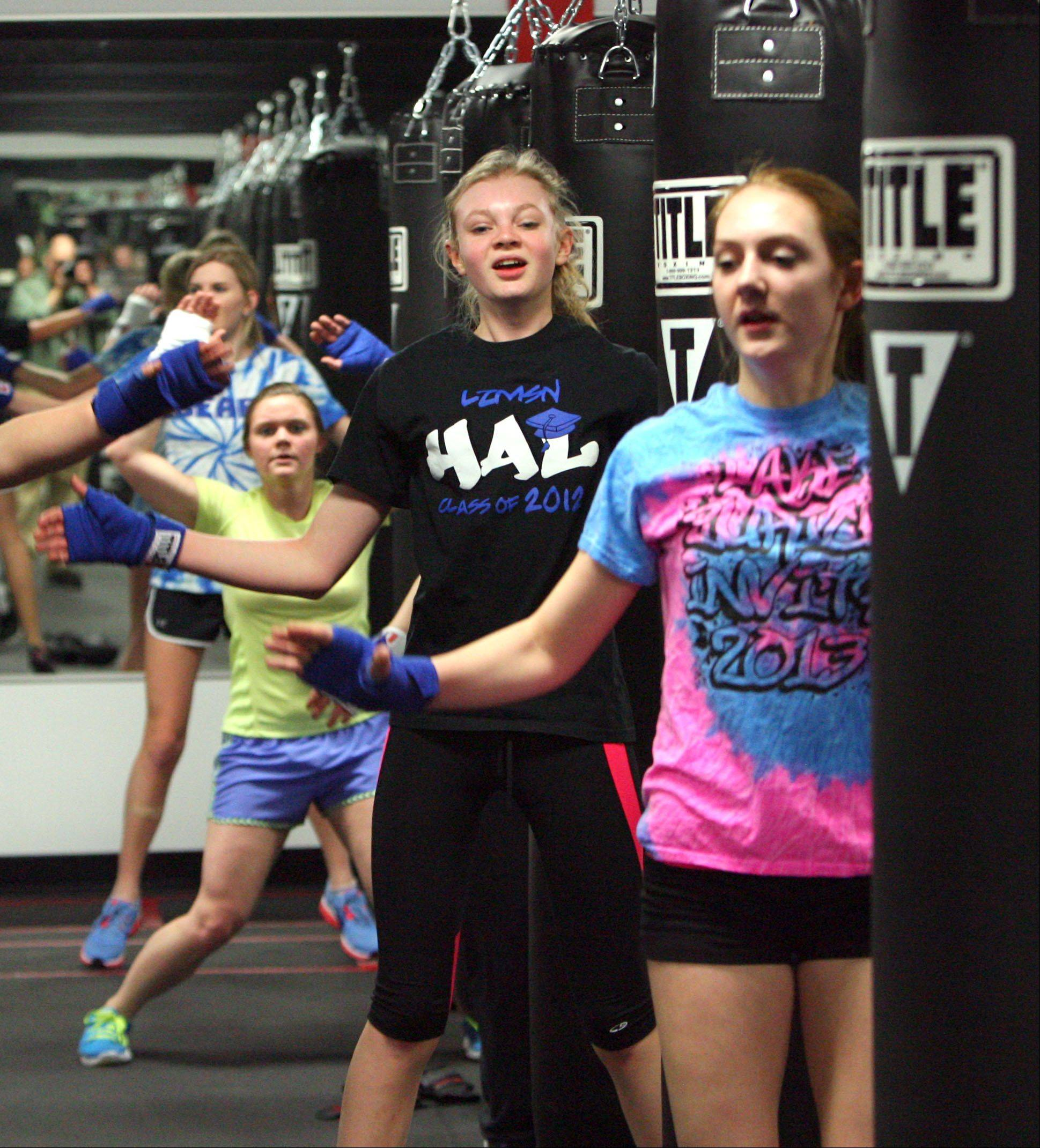 The Lake Zurich girls jv lacrosse club participated in a kick-boxing workout at Title Boxing Club in Lake Zurich Friday.