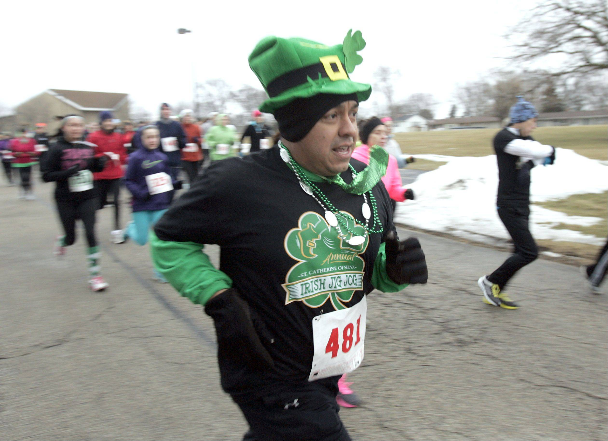 Warner Cruz, of Itasca, heads out of the starting gate during the Irish Jig Jog 5K Race and Pancake Breakfast at St. Catherine of Siena in West Dundee Saturday.