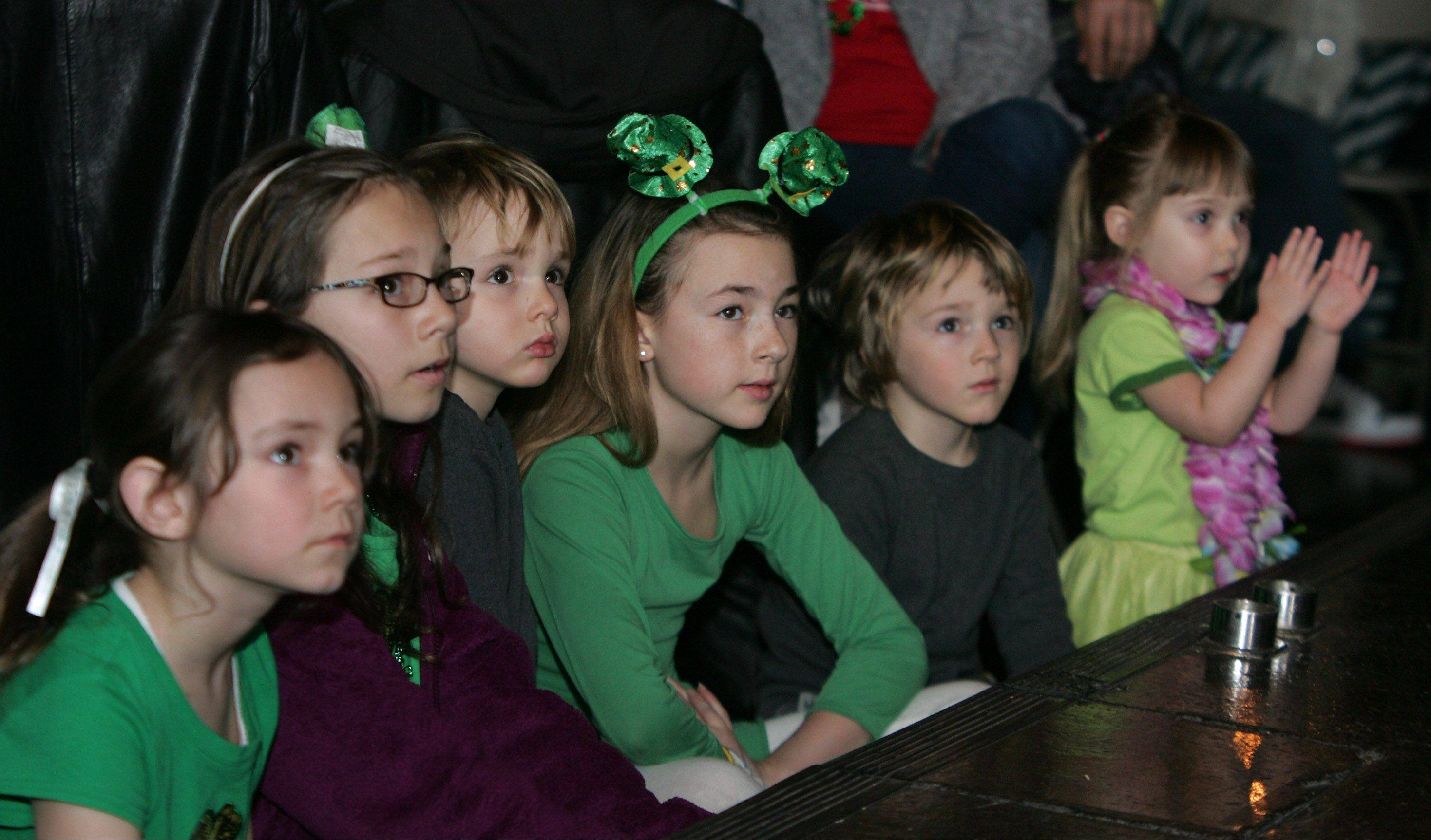 Children watch the Trinity Irish Dancers perform on St. Patrick's Day before a packed house Sunday at Mickey Finn's Brewery in Libertyville. The group has been performing the traditional Irish dance in the Chicago area for over 30 years.
