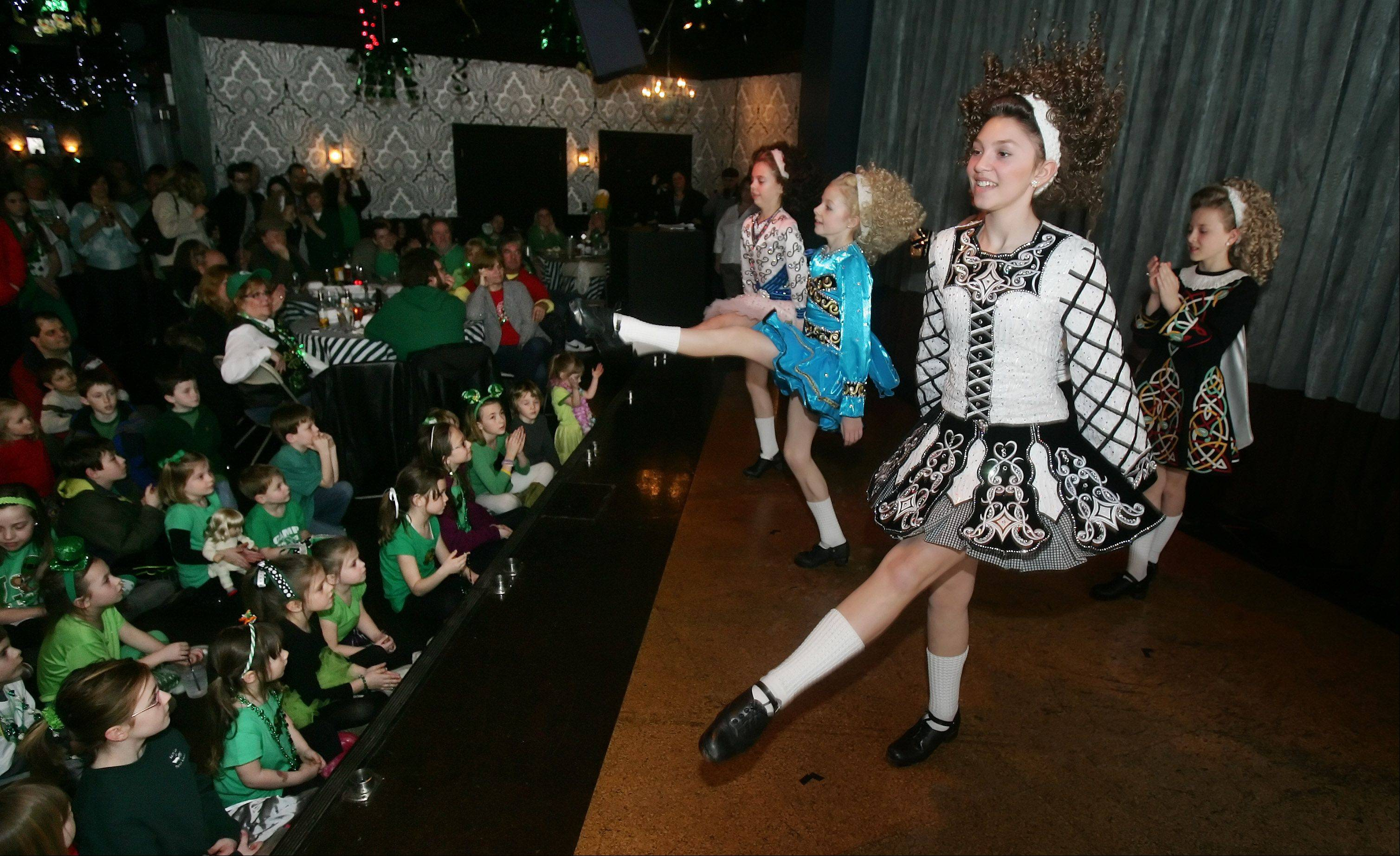 The Trinity Irish Dancers performed on St. Patrick's Day before a packed house Sunday at Mickey Finn's Brewery in Libertyville. The group has been performing the traditional Irish dance in the Chicago area for over 30 years.