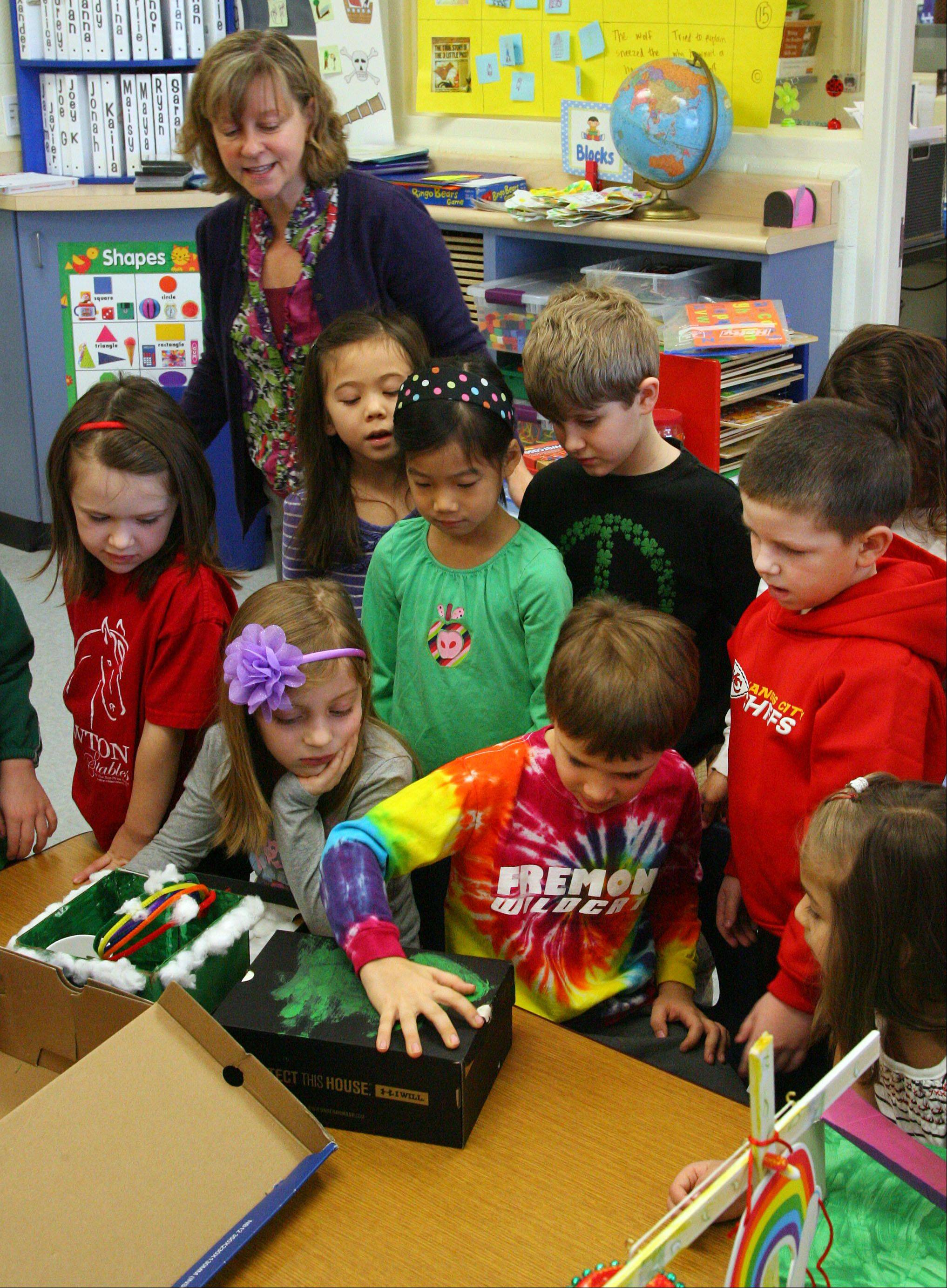 Fremont Elementary kindergartener Joey Kafka shows classmates how his leprechaun trap works during Wendy Domanico's class Thursday in Mundelein.