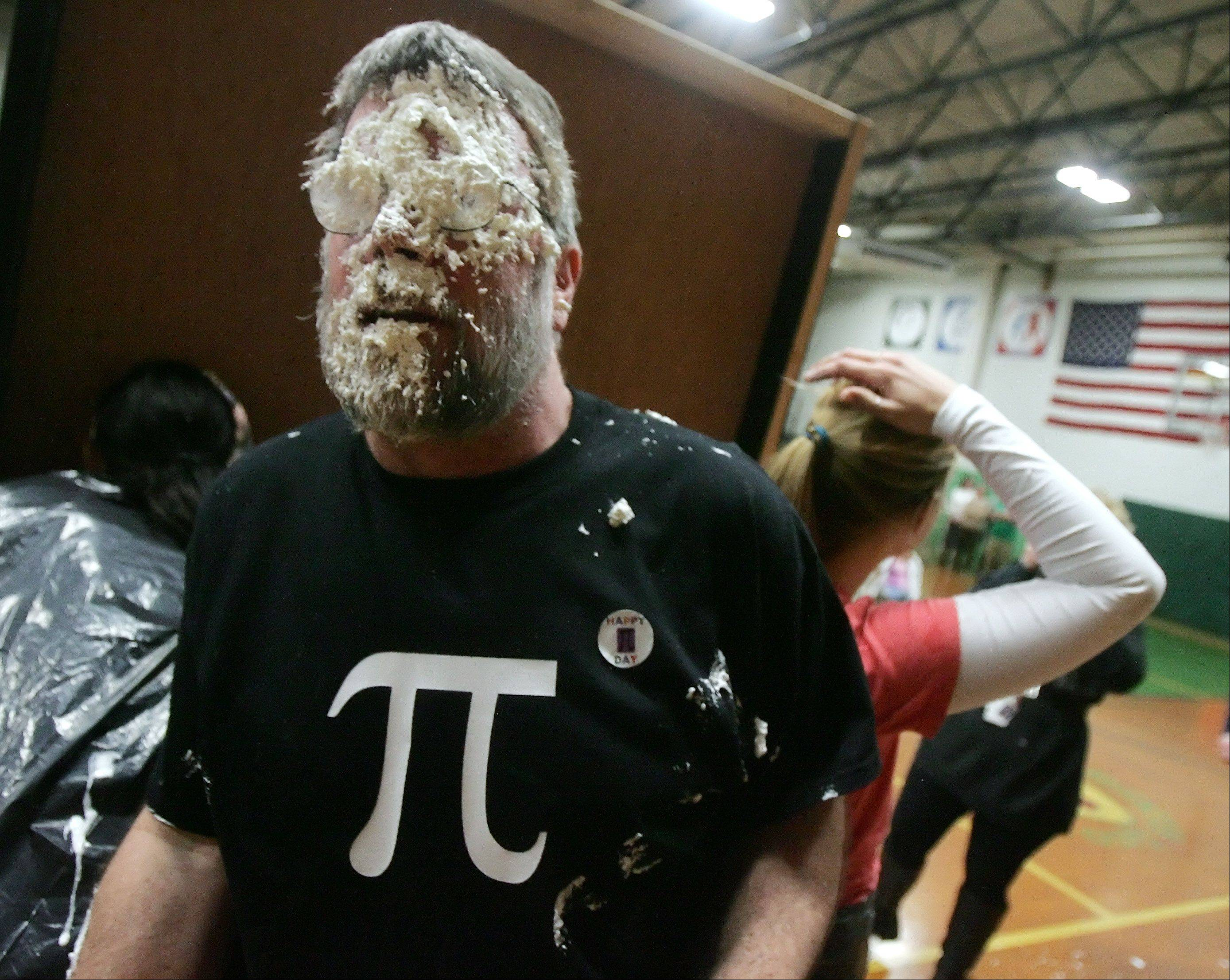 Math teacher Don Doll is covered in whip cream after a student threw a pie in his face at Fremont Middle School in Mundelein Thursday as part of a Pi Day fundraiser for St. Jude Children's Research Hospital.