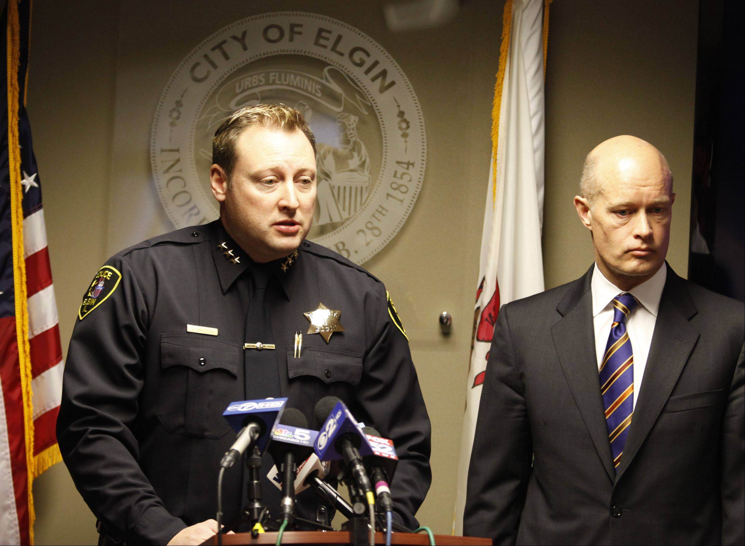 Elgin Police Chief Jeff Swoboda, left, and Kane County State's Attorney Joe McMahon announce charges against Paul Johnson, 34, in the murder of his neighbor Lisa Koziol-Ellis.