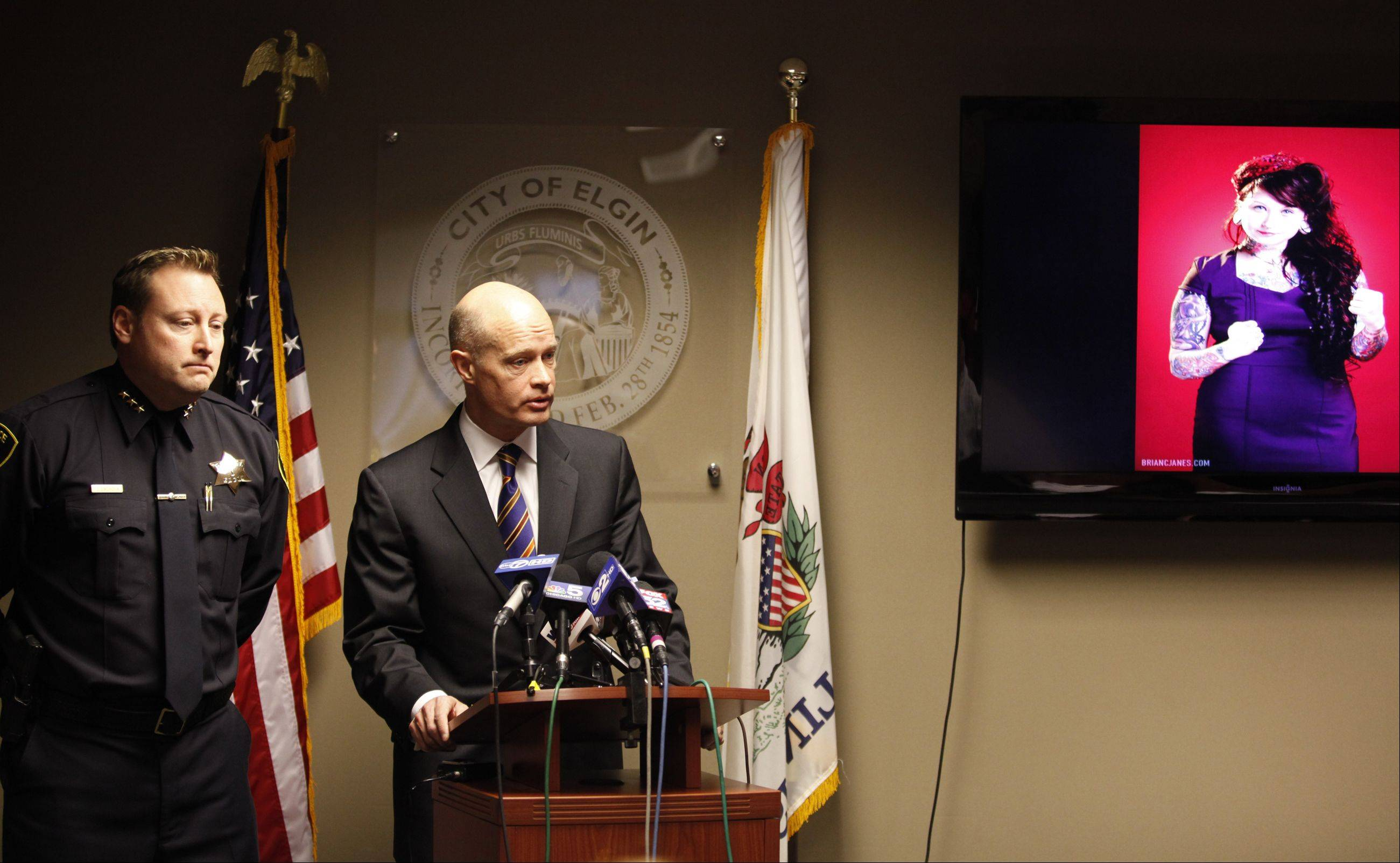 Kane County State's Attorney Joe McMahon announces charges filed against Paul Johnson in the murder of his neighbor Lisa Koziol-Ellis of Elgin. Police Chief Jeff Swoboda is at left.