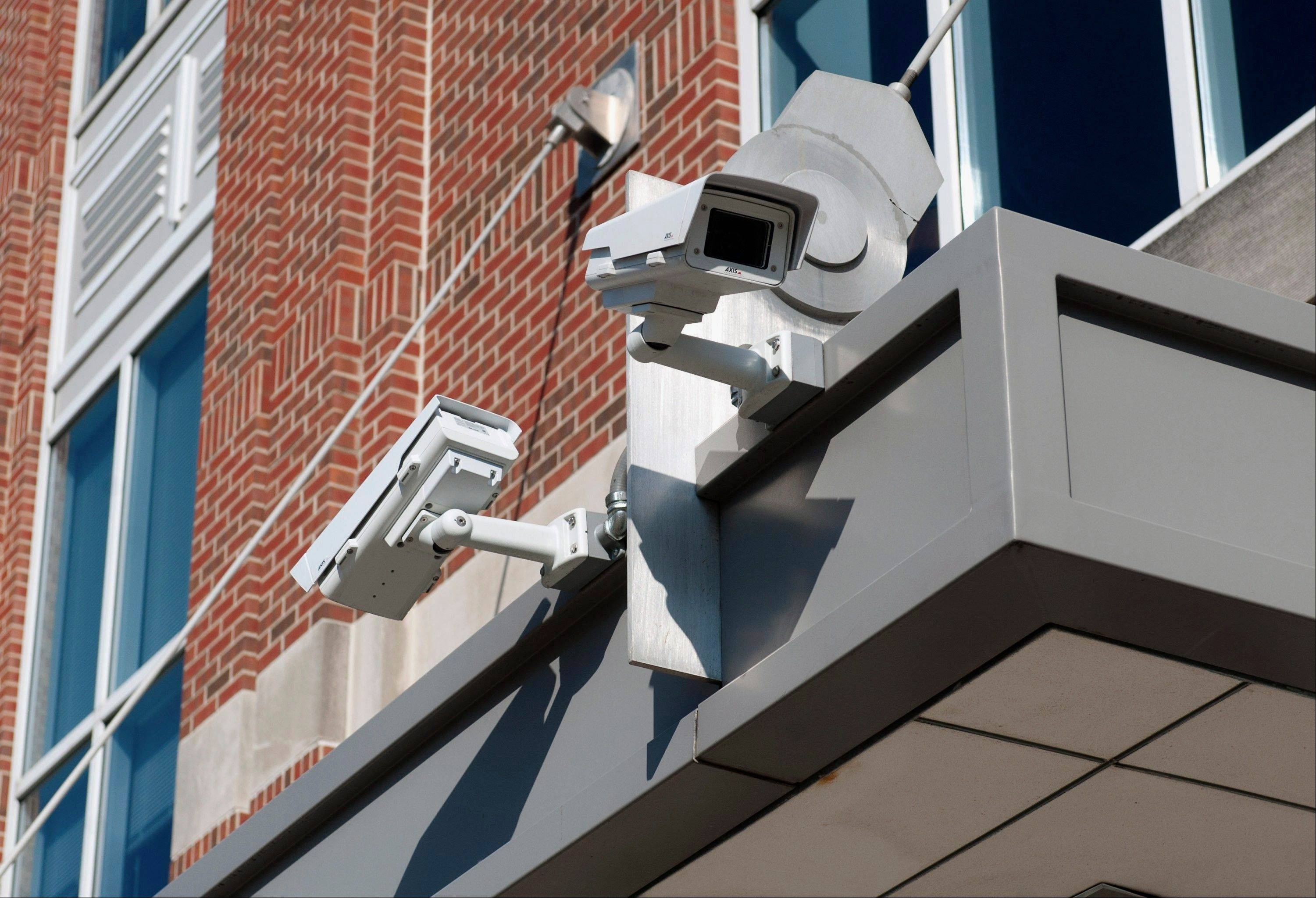 Surveillance cameras are mounted outside of the Illini Union Bookstore in Champaign. The campus had 13 surveillance cameras in 2008. Now the number is at 900.