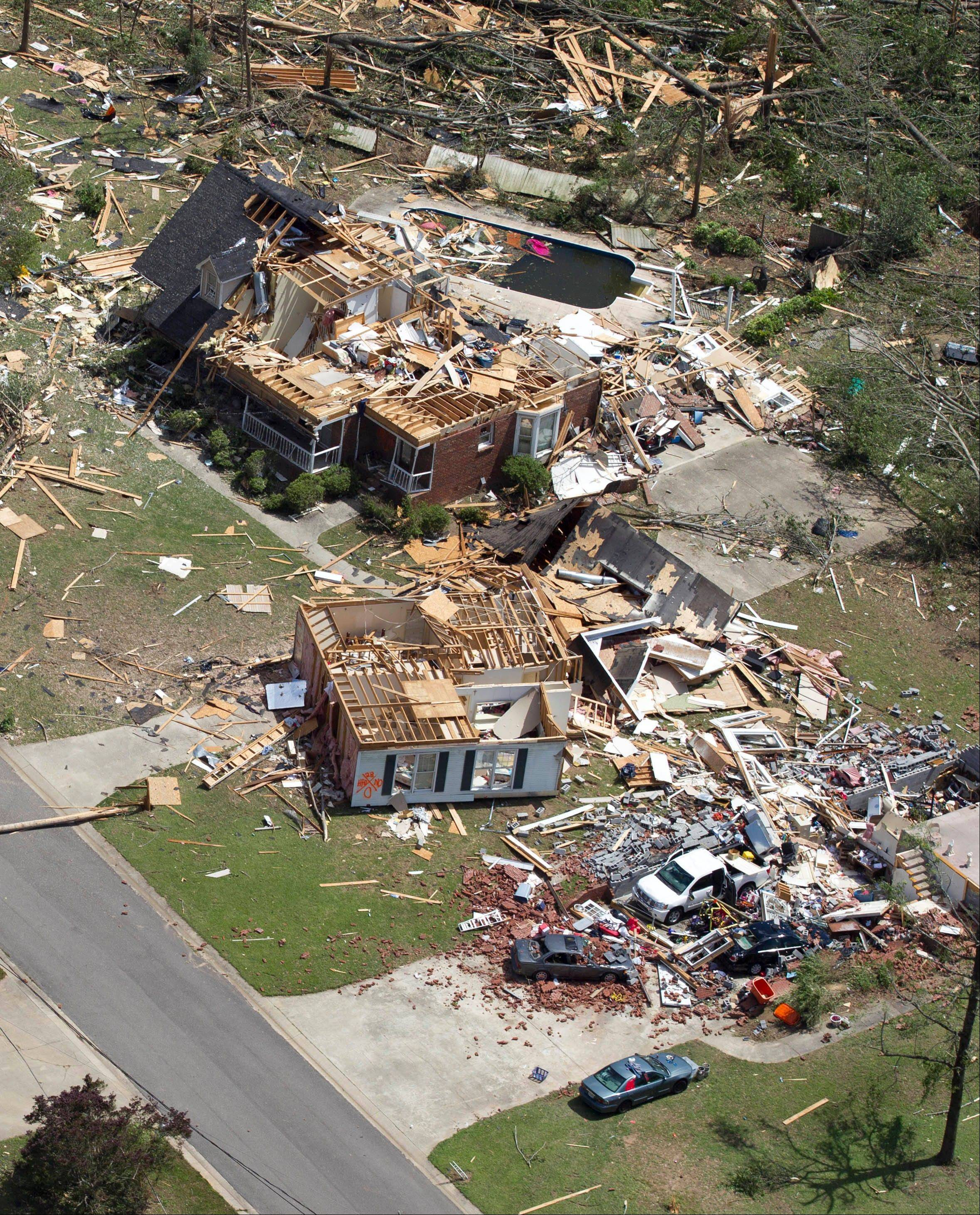 This aerial photo taken April 28, 2011, shows tornado damage in Pleasant Grove, Ala. The photos and mementoes that were blown for hundreds of miles during the tornado outbreak two years ago are giving researchers new insight on how debris is carried. University of Georgia associate professor John Knox says a new study has documented how one photo traveled nearly 220 miles through the atmosphere over Alabama and Tennessee.