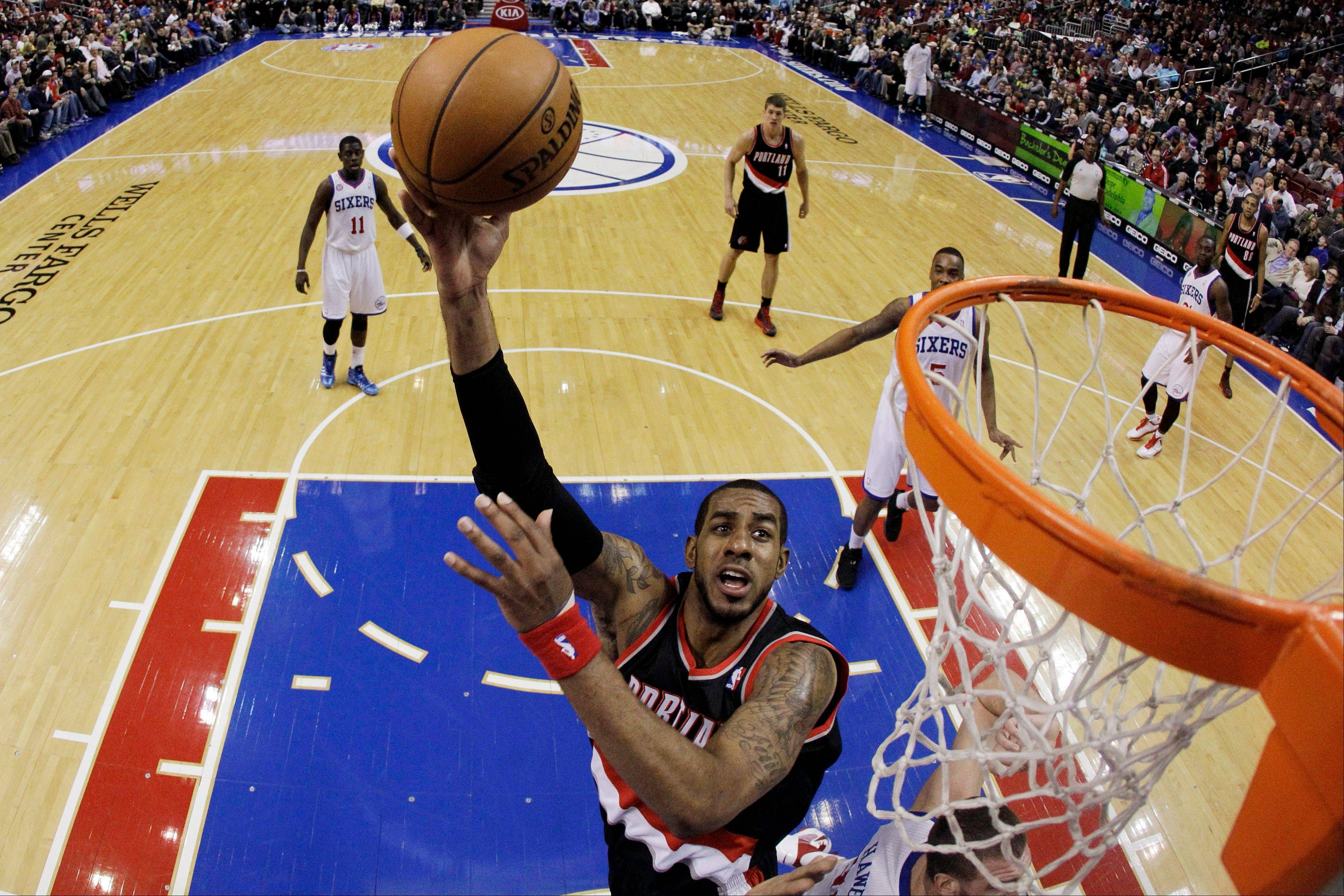Portland Trail Blazers' LaMarcus Aldridge shoots during the first half of an NBA basketball game against the Philadelphia 76ers on Monday in Philadelphia.