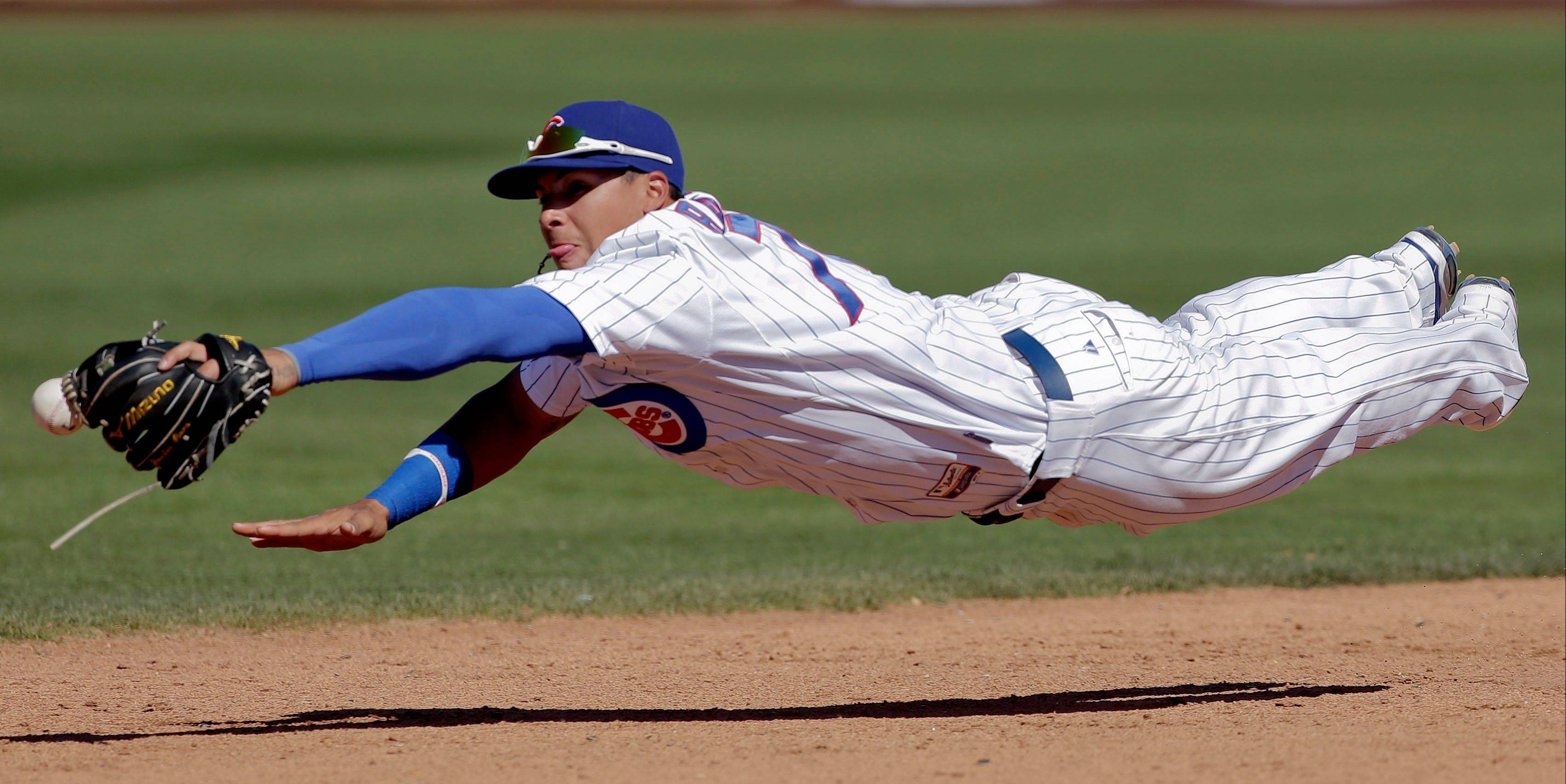 Cubs shortstop Javier Baez can't get a glove on a hit by Colorado's Eric Young Jr. last Wednesday. Baez, who was sent to the minors Monday, is very appreciative of the advice given by Alfonso Soriano.