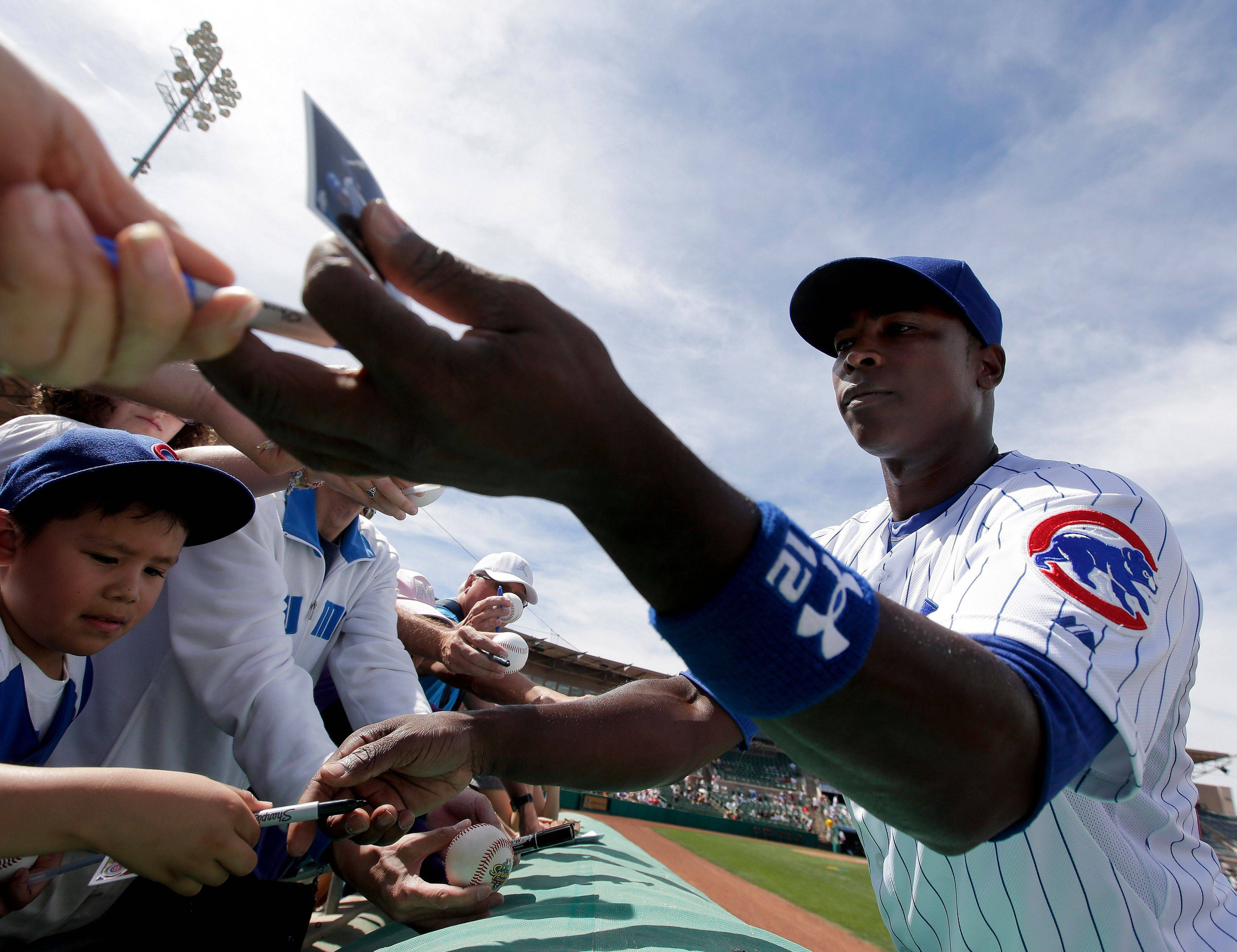 Alfonso Soriano, here signing autographs last week, doesn't want Cubs youngsters to make mistakes in the minor leagues that can derail their path to the big club.