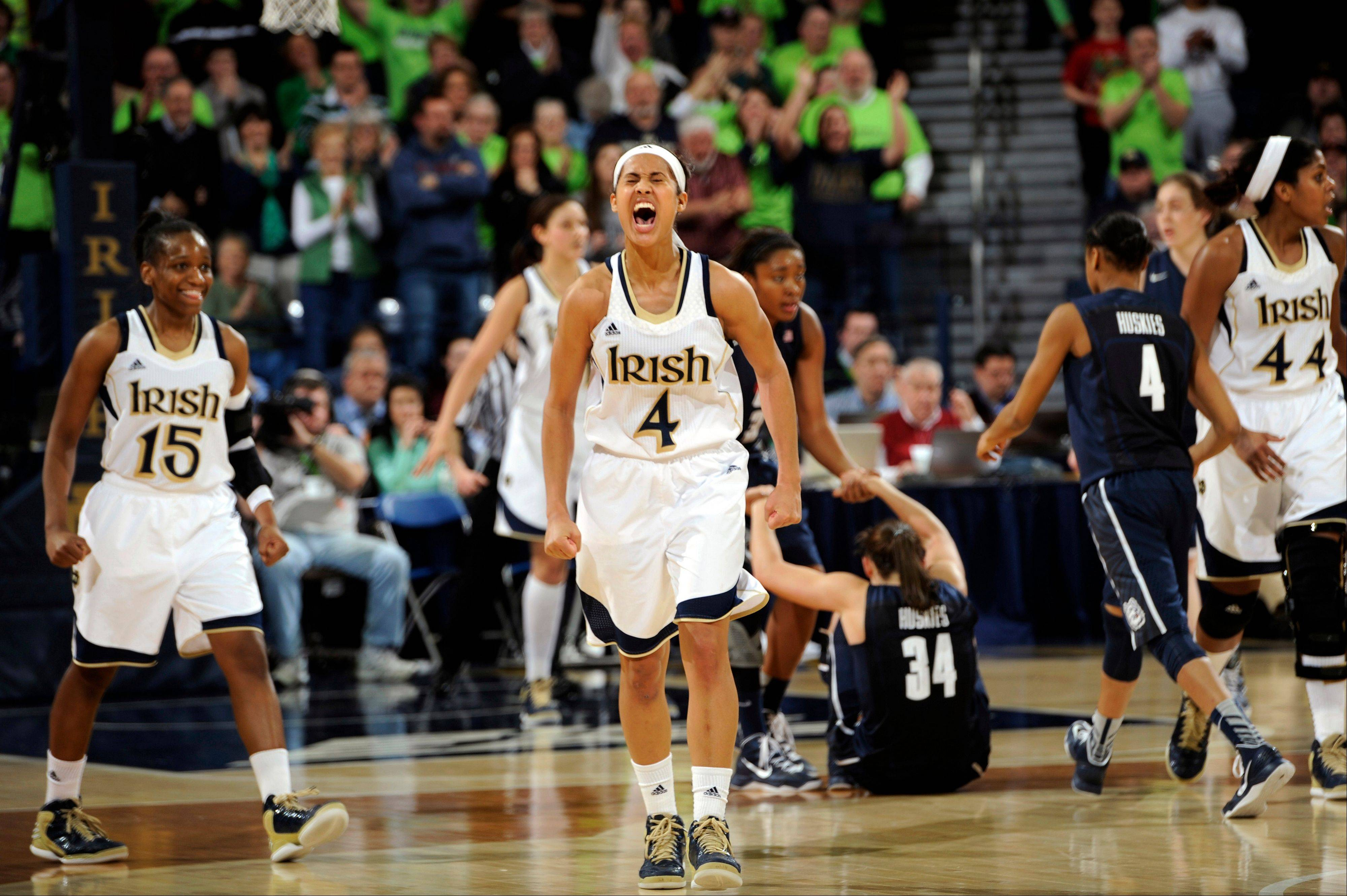 In this March 4, 2013, file photo, Notre Dame guard Skylar Diggins (4) celebrates a steal and the subsequent Connecticut foul during the third overtime of an NCAA college basketball game, Monday, March 4, 2013, in South Bend, Ind. Notre Dame was announced Monday, March 18, to join Connecticut, Stanford and Baylor as a No. 1 seed in the women's tournament, marking the second straight season those four schools were the top seeds.