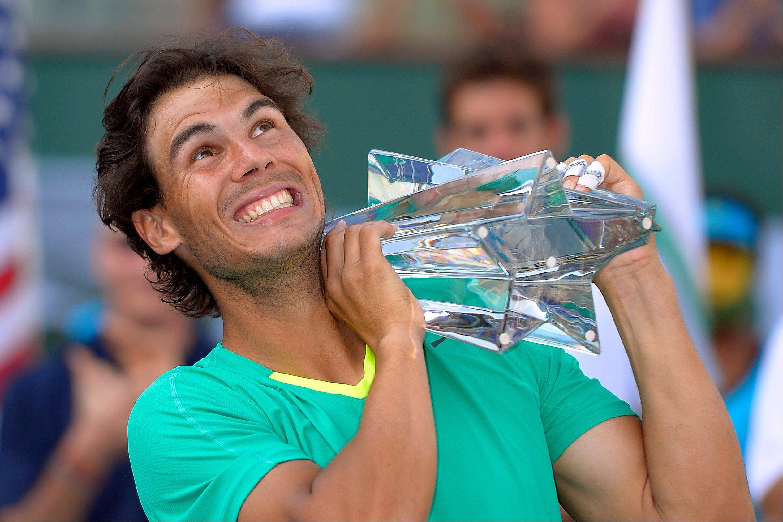 Rafael Nadal, of Spain, poses with the trophy after defeating Juan Martin del Potro, of Argentina, 4-6, 6-3, 6-4, in their match at the BNP Paribas Open tennis tournament Sunday in Indian Wells, Calif.