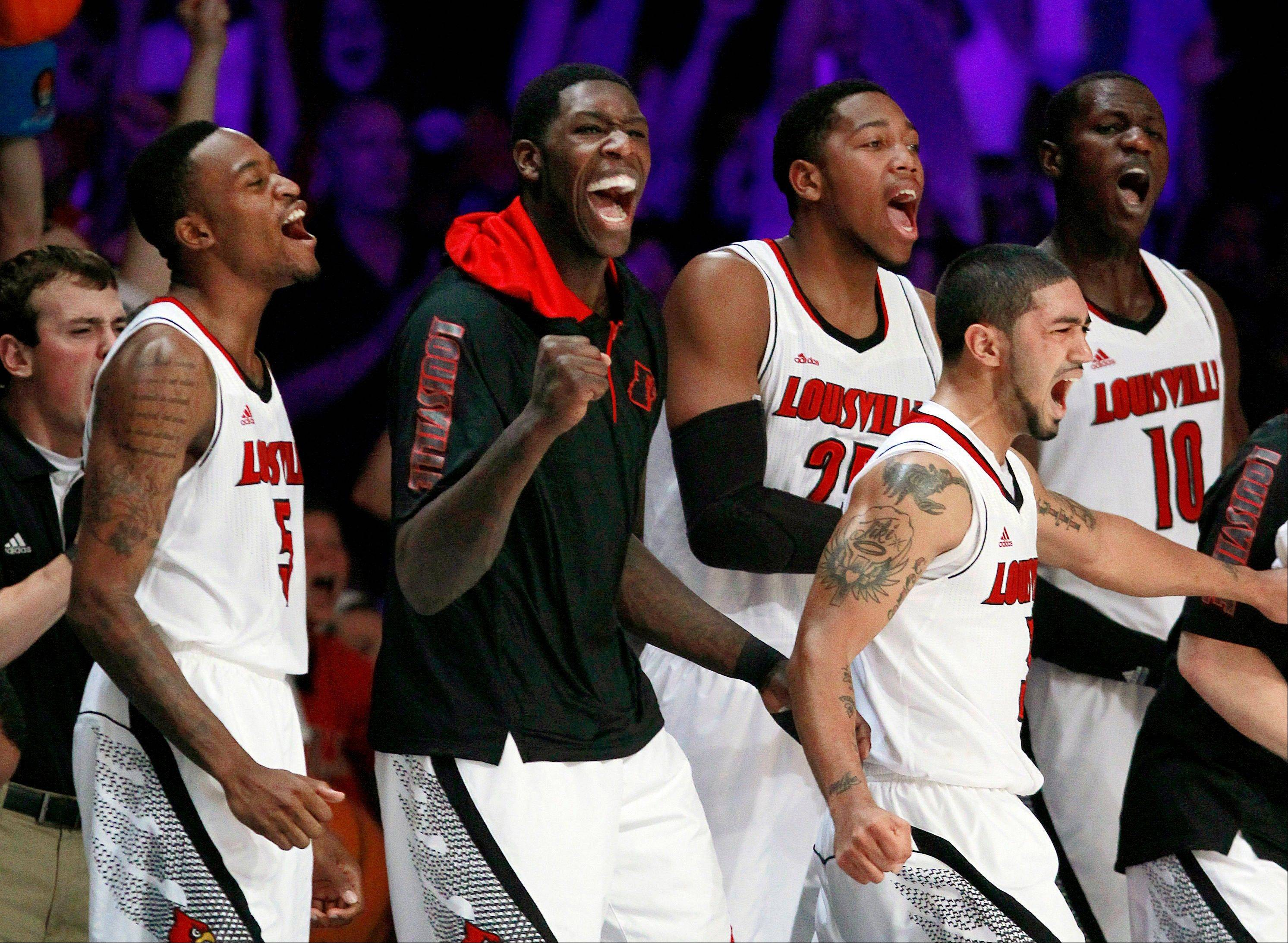 In this Nov. 23, 2012, file photo, Louisville's Kevin Ware (5), Montrezl Harrell (24), Peyton Siva, Zach Price (25) and Gorgui Dieng (10) react after a basket in the second half of an NCAA college basketball game in Paradise Island, Bahamas. The Cardinals have shown that they are comfortable being front-runners in their season-long quest to go farther than last year's Final Four appearance. Now, they enter the NCAA tournament as the overall No 1 seed.