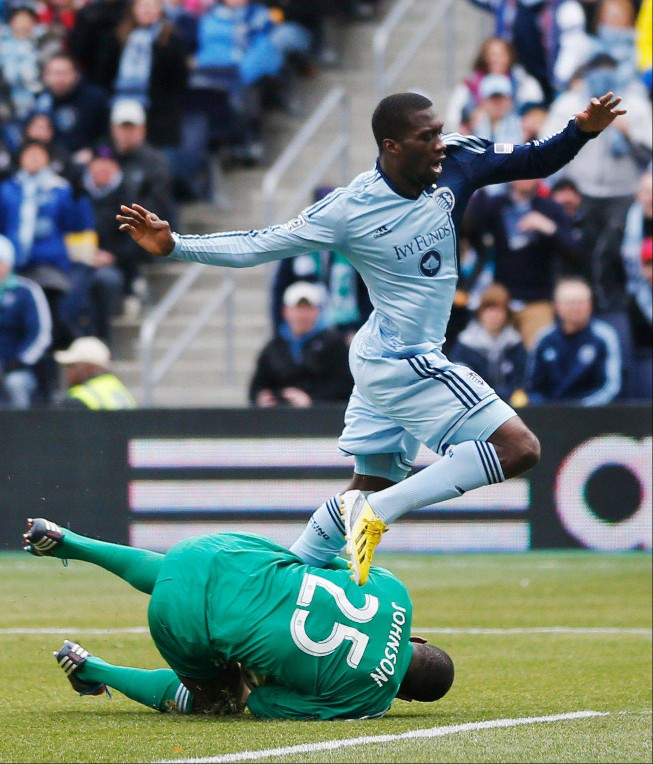 Sporting KC forward C.J. Sapong leaps over Chicago Fire goalkeeper Sean Johnson during Saturday's match in Kansas City, Kan. Johnson, who has been called to join the U.S. National Team, earned his 16th MLS shutout in the match.