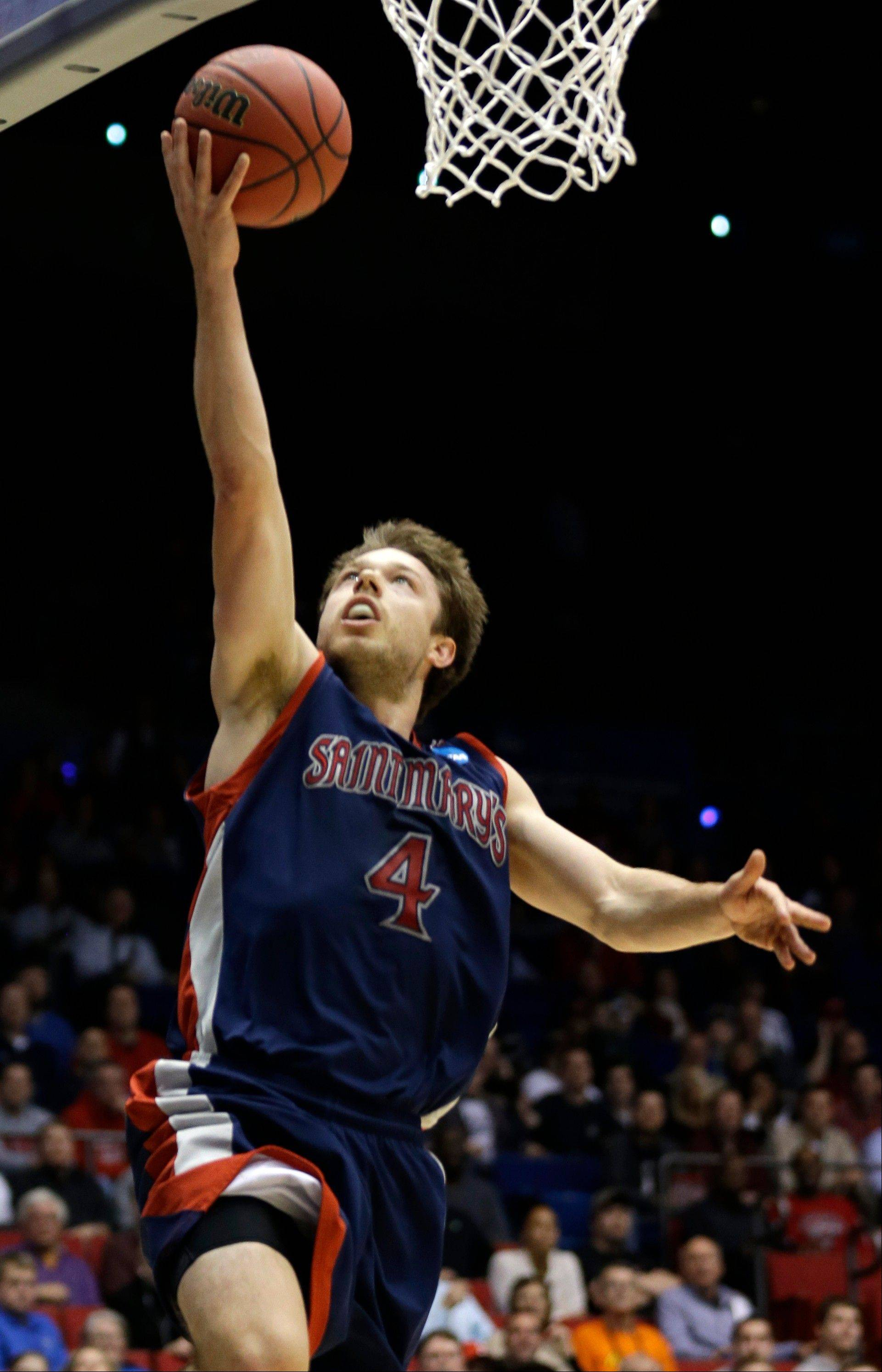 St. Mary's guard Matthew Dellavedova scores against Middle Tennessee in the first half of a first-round game of the NCAA men's college basketball tournament, Tuesday, March 19, 2013, in Dayton, Ohio. (AP Photo/Al Behrman)
