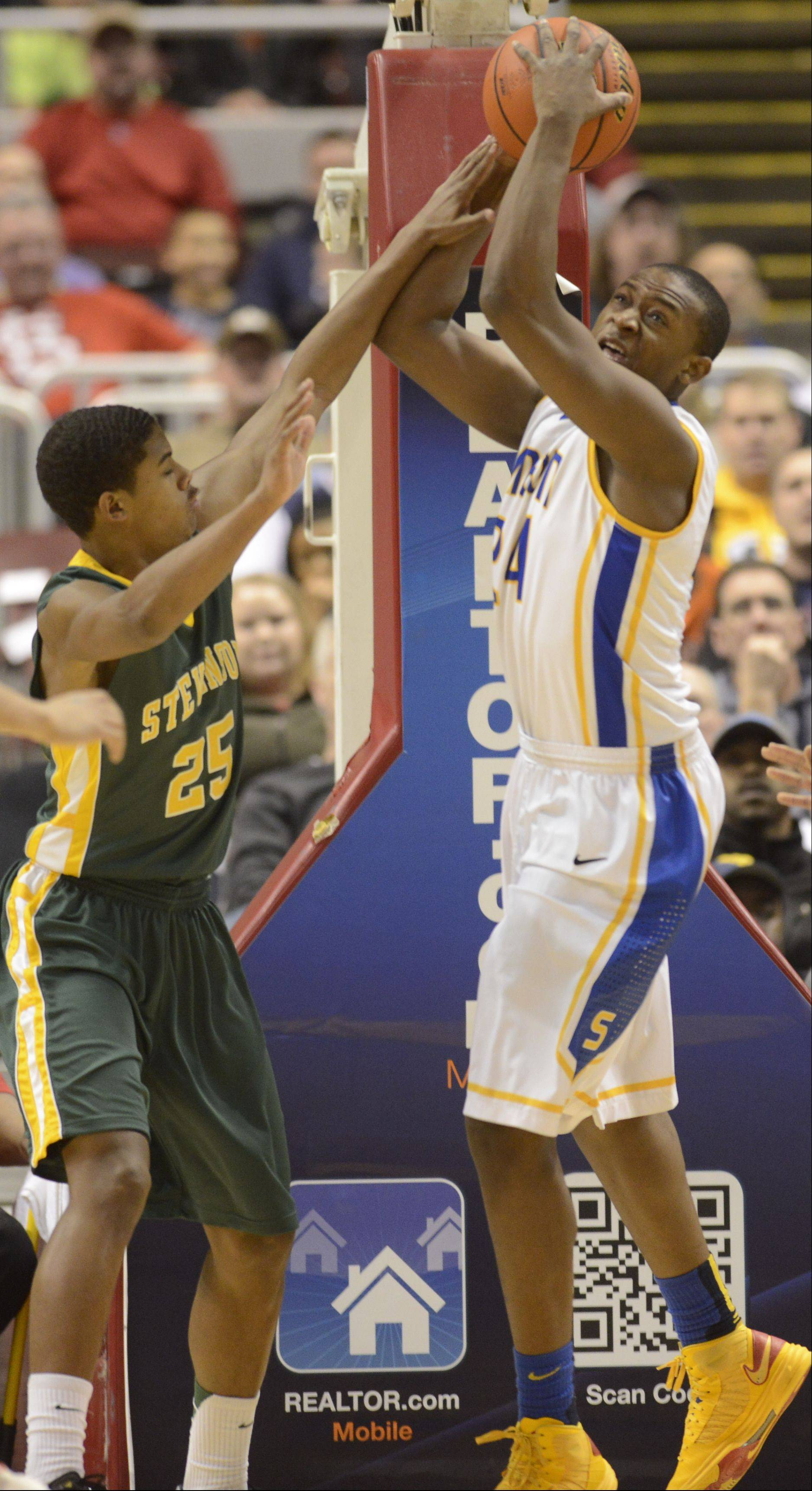 Stevenson�s Cameron Green, left, defends Simeon�s Kendall Pollard during the Class 4A state championship game Saturday in Peoria.