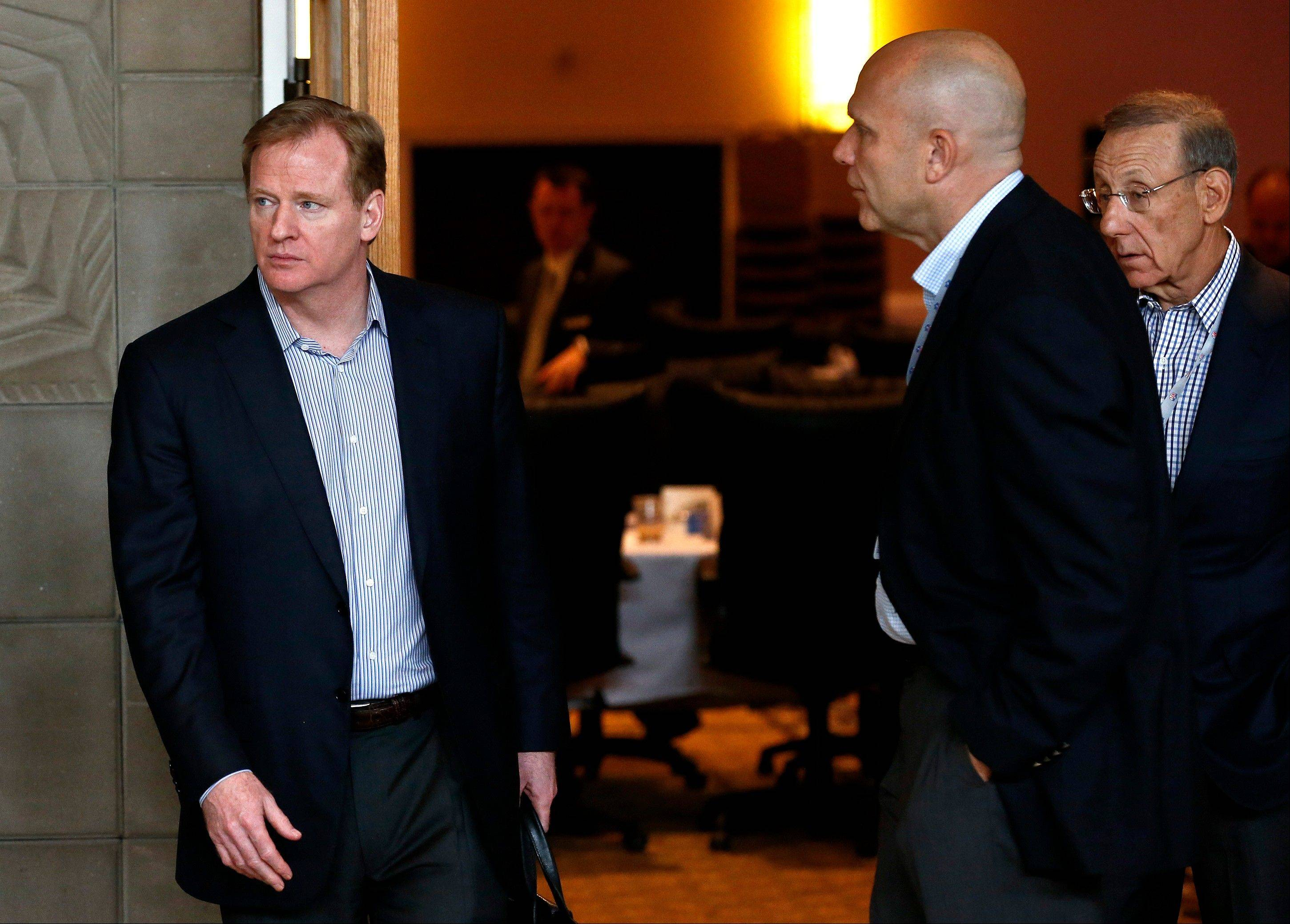 NFL Commissioner Roger Gooderll, left, walks with Miami Dolphins owner Stephen Ross, far right, and Dolphins CEO Mike Dee during the annual NFL footbal meetings at the Arizona Biltmore, Tuesday, March 19, 2013, in Phoenix. (AP Photo/Ross D. Franklin)