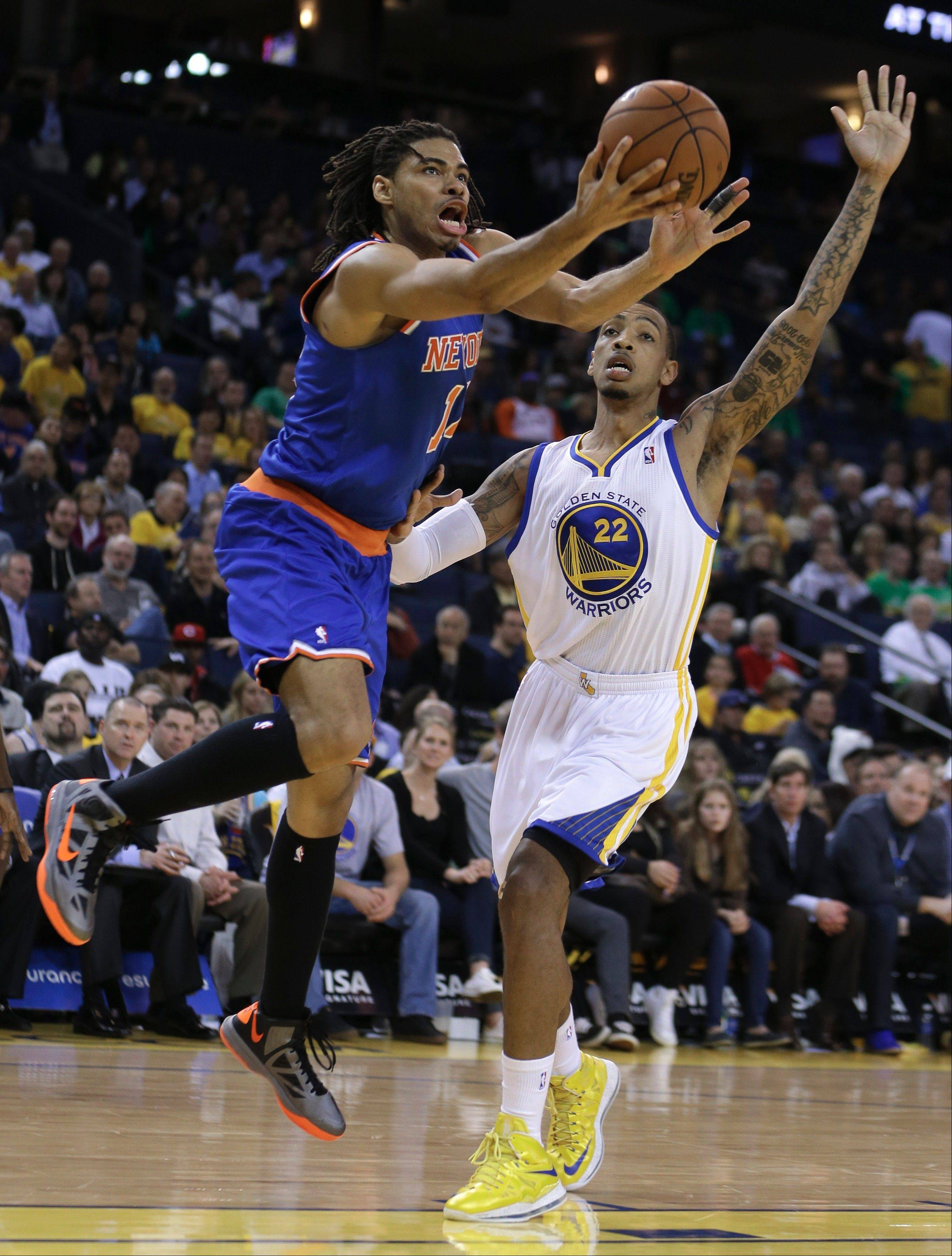 Former Golden State Warriors forward Malcolm Thomas, here defending against the Knicks, has signed a 10-day contract with the Chicago Bulls.