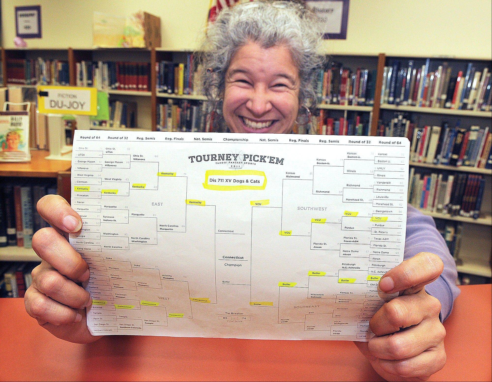 Jefferson High School librarian Diana Inch posted the winning NCAA tournament bracket in the 2011 Yahoo.com's online contest in Jefferson, Ore. The odds of completing the perfect bracket by picking the higher-seeded team are 35 billion to 1.