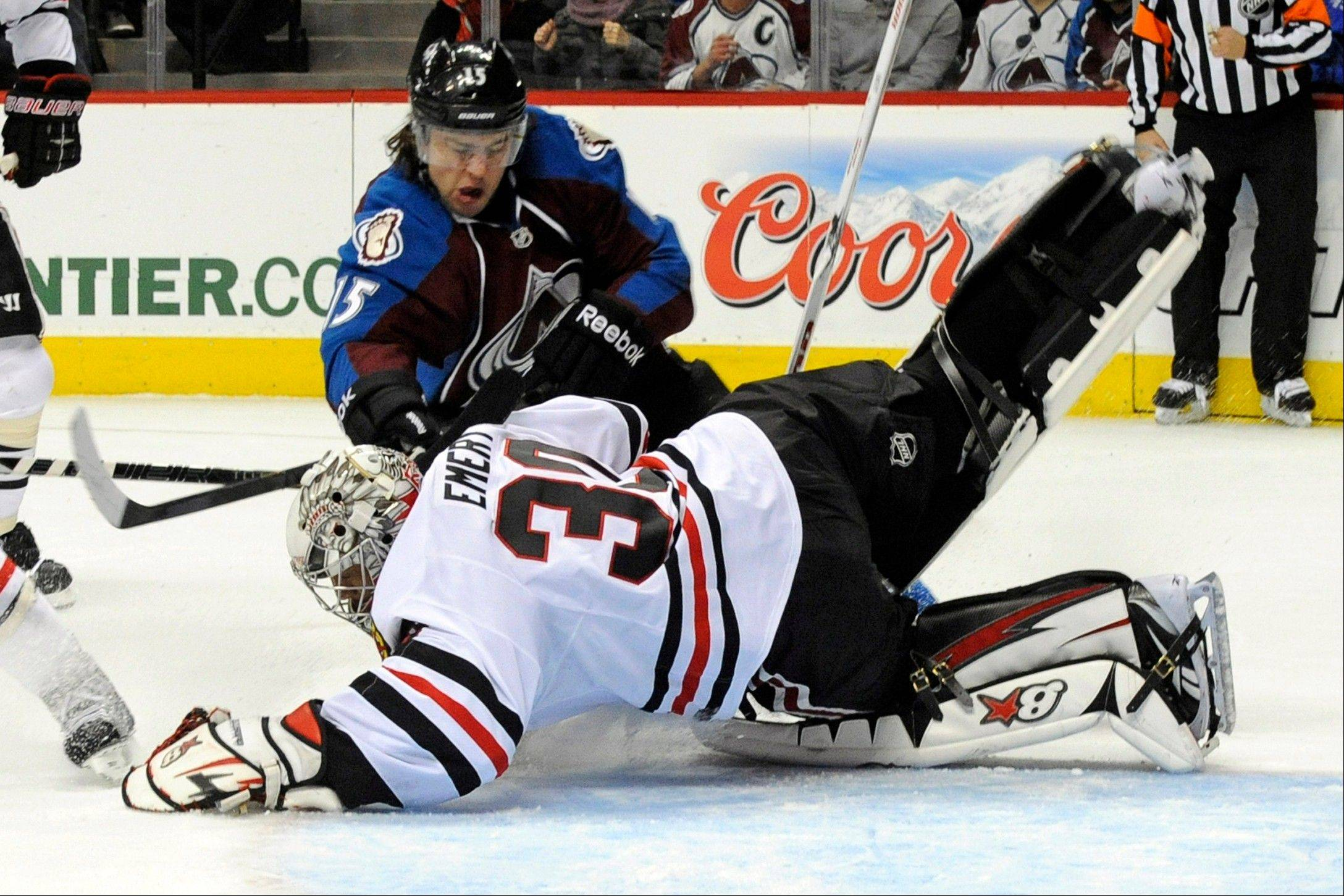 Chicago Blackhawks goalie Ray Emery (30) dives to make a save against Colorado Avalanche right wing P.A. Parenteau (15) during the first period.