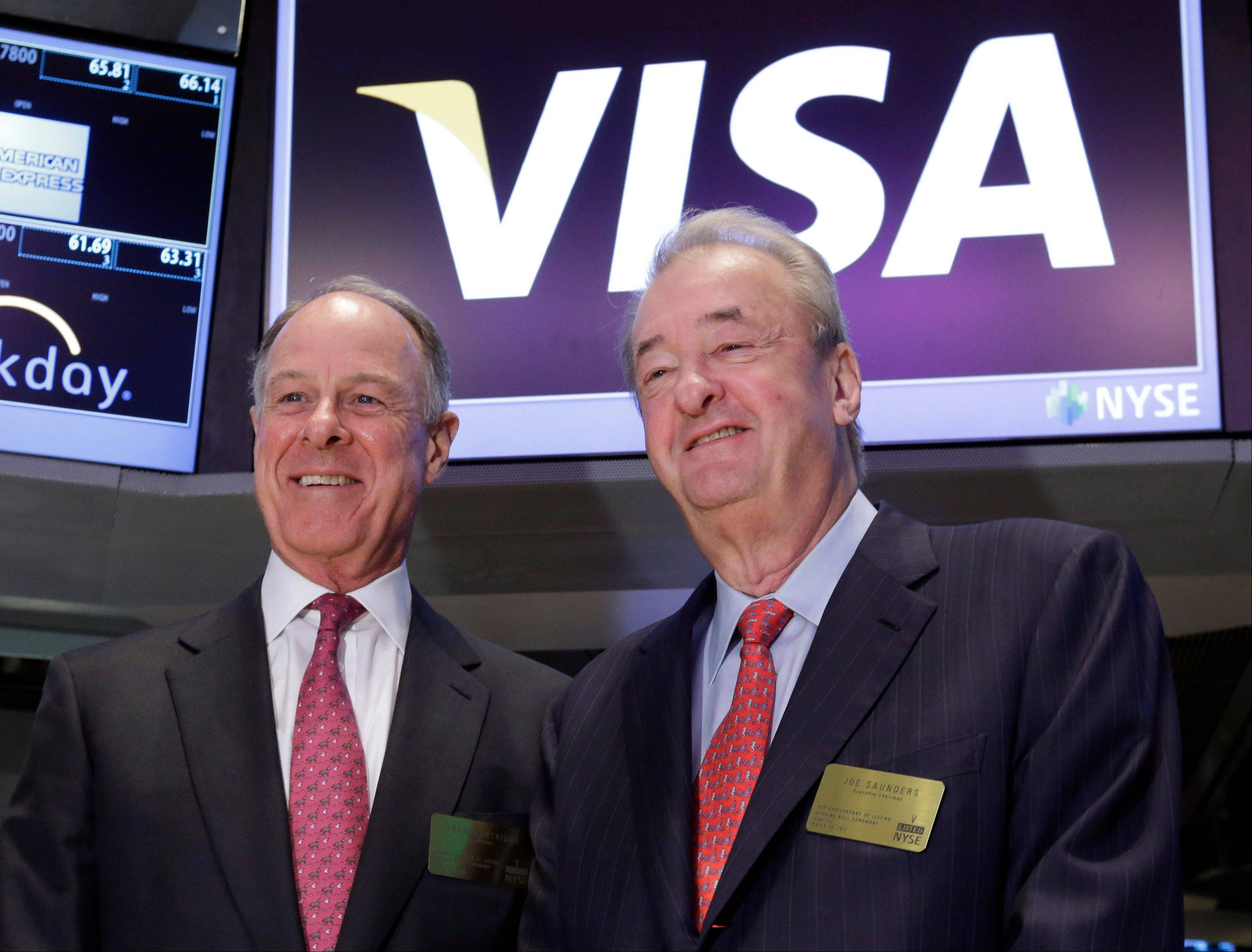 Visa President John Partridge, left, and Executive Chairman Joseph Saunders pose on the floor of the New York Stock Exchange before ringing the opening bell Tuesday. Stocks fell, sending the Standard & Poor's 500 Index to its longest slump of the year, as Cypriot lawmakers' rejection of a bank levy overshadowed data showing growth in new-home construction.